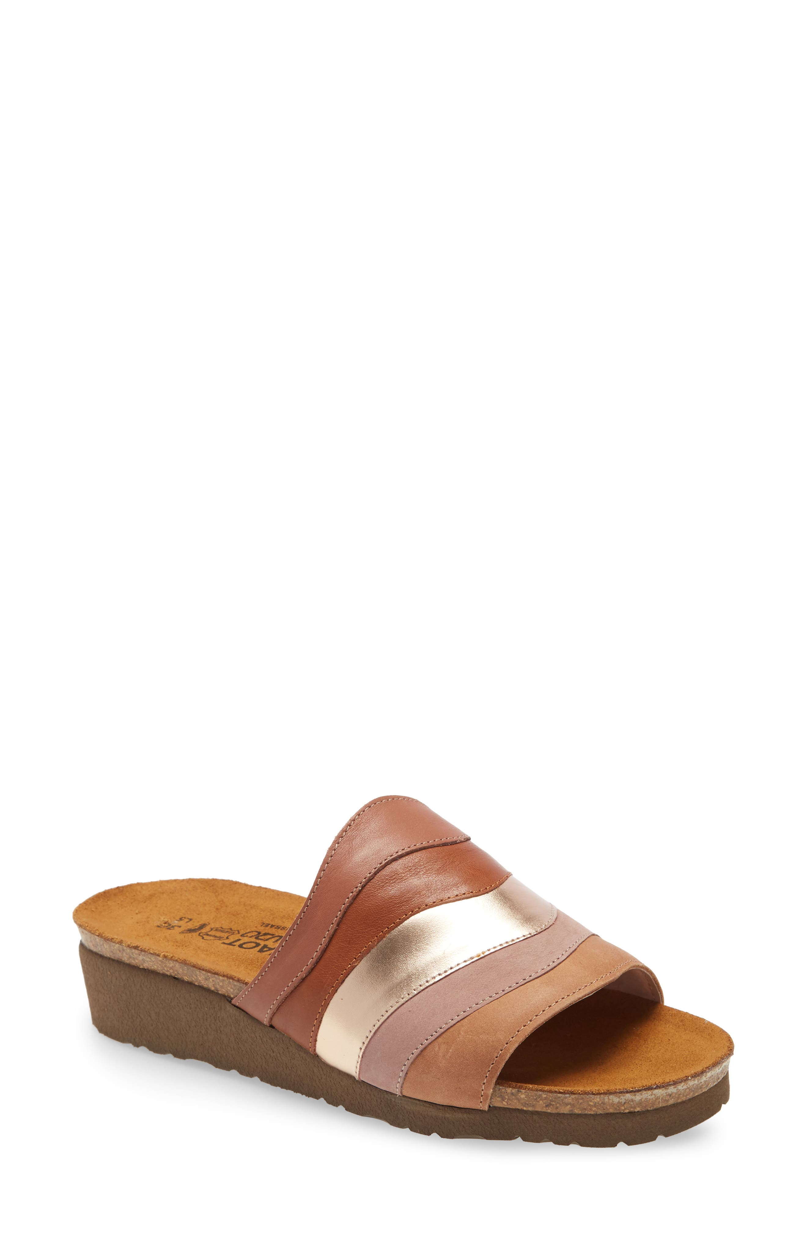 A flicker of metallic leather shines on the wavy multicolored vamp of a comfortable wedge slide with a supportive molded footbed that cushions every step. Style Name: Naot Portia Slide Sandal (Women). Style Number: 6003952. Available in stores.