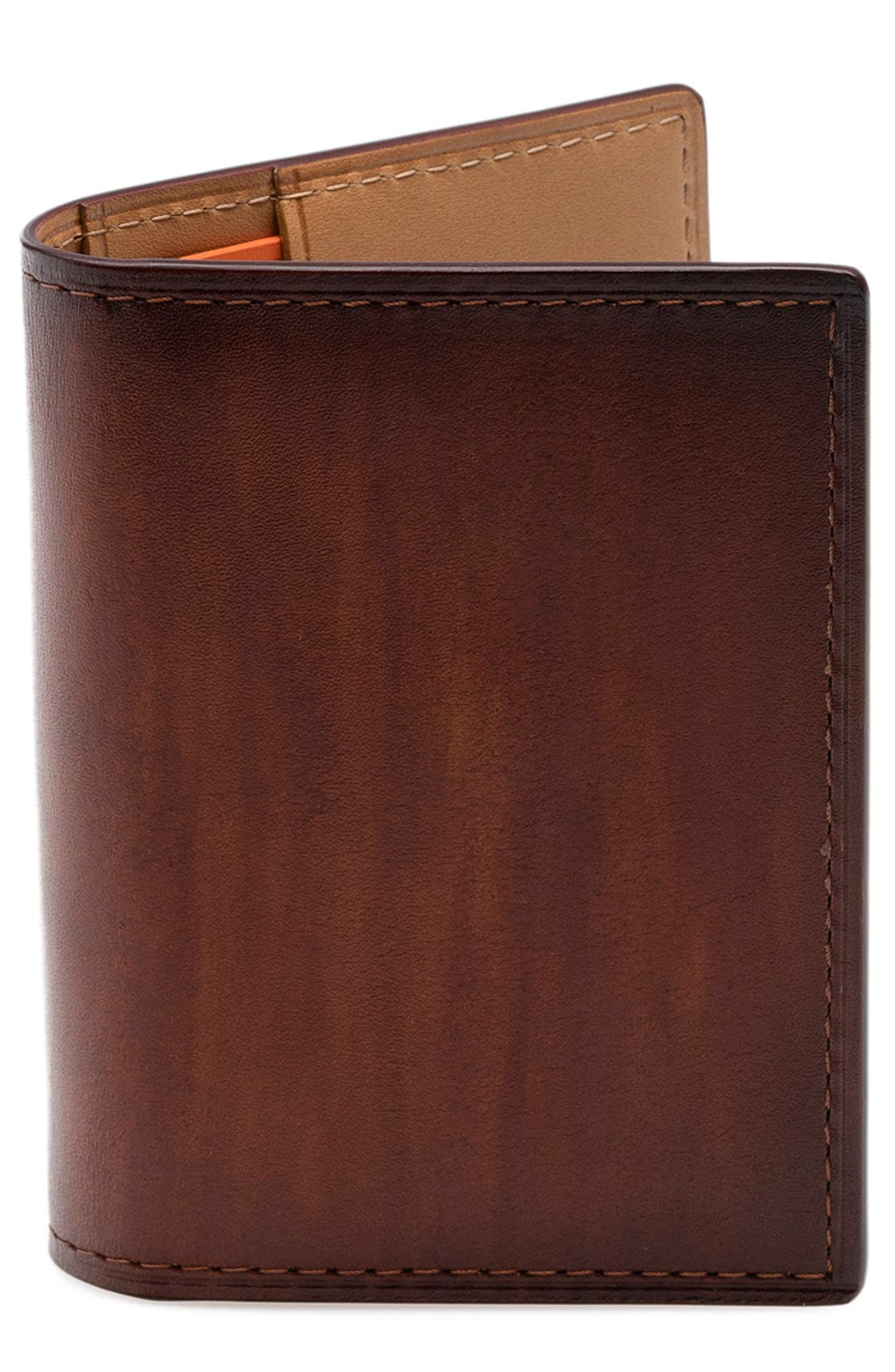 A slim card case with an ID window and two slots for your cards is cut from Italian leather in beautifully tanned and dyed patinas that becomes more defined over time. Style Name: Magnanni Leather Card Case. Style Number: 5461344. Available in stores.