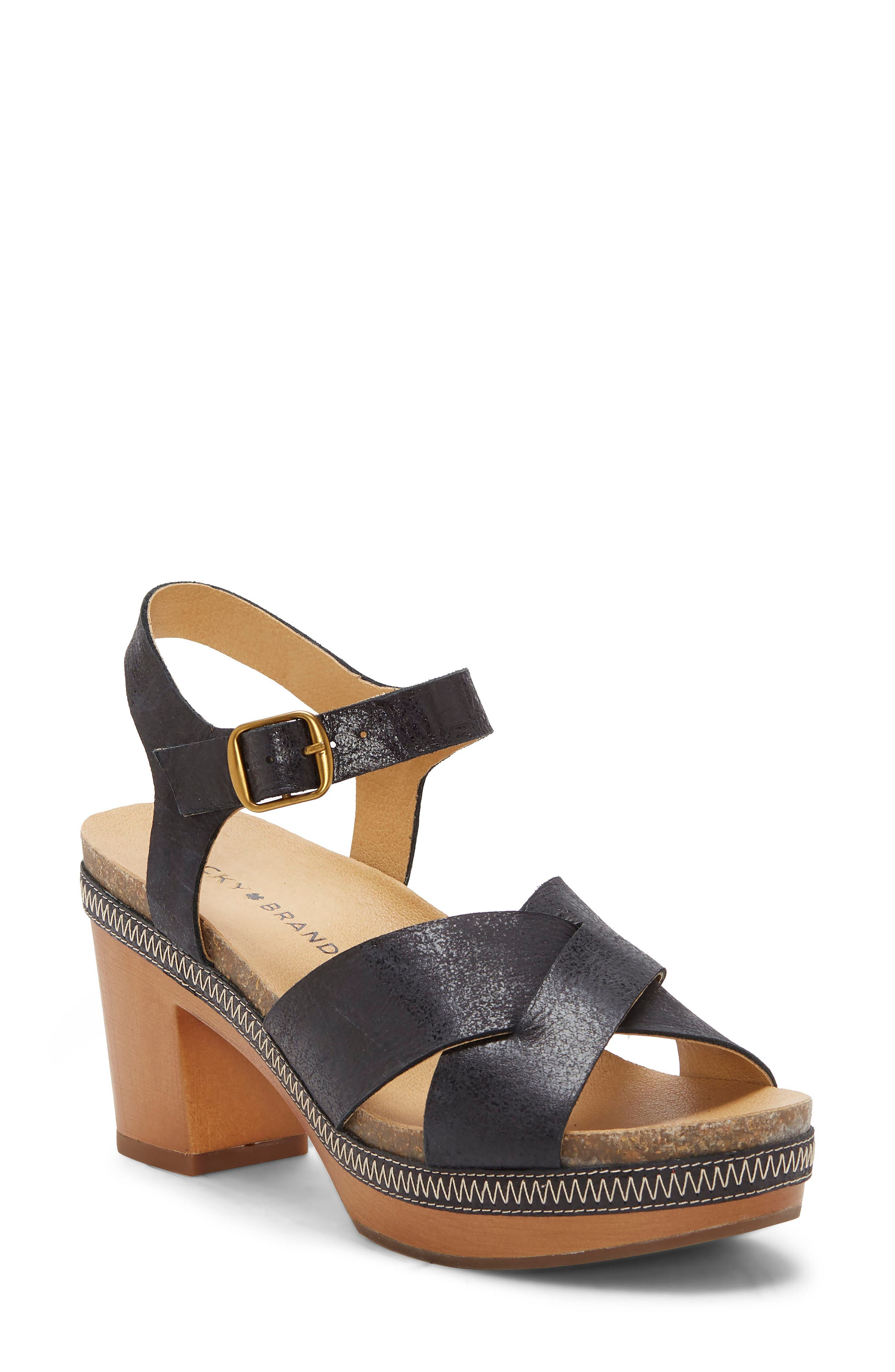 A chunky woodgrain platform and heel bring old-school style to a breezy sandal with contrast stitching detailing the midsole. Style Name: Lucky Brand Harvia Platform Sandal (Women). Style Number: 5958397. Available in stores.