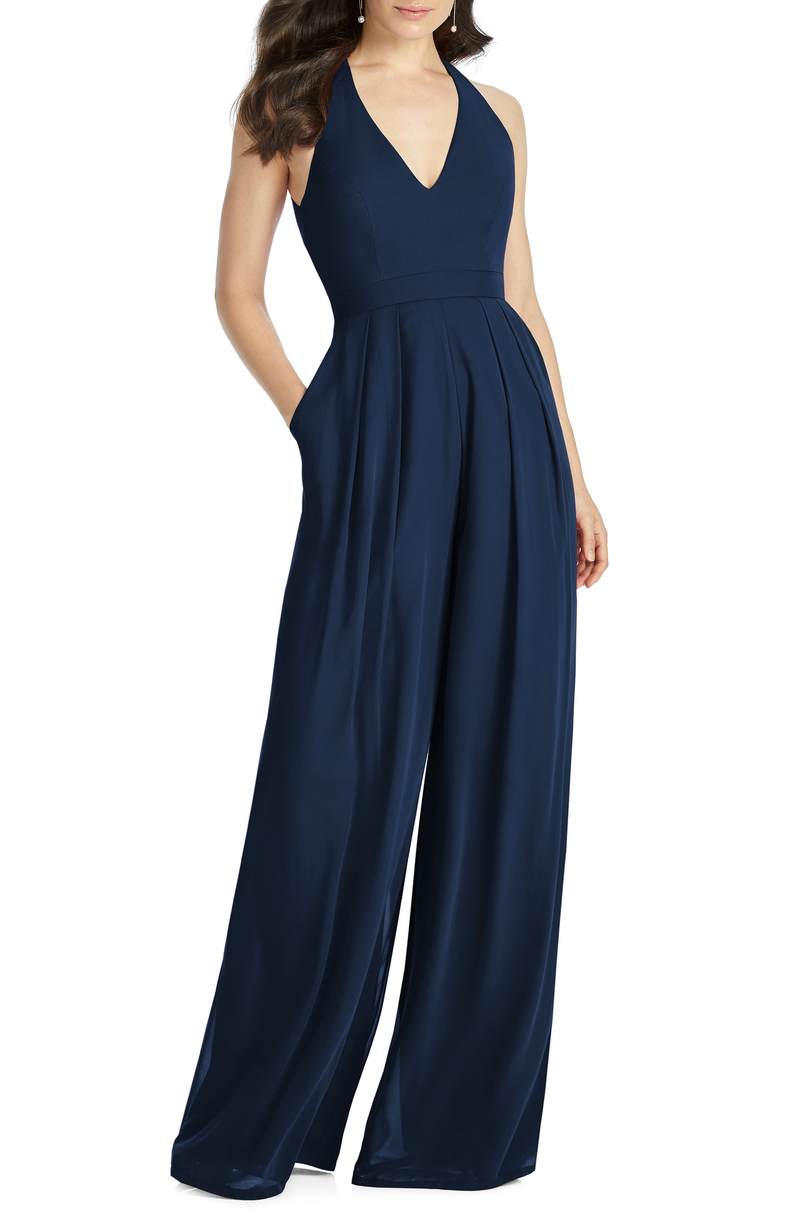 A winning option for formalwear with less fuss, this chiffon jumpsuit features a chic back cutout as well as wide legs and a pleated front for a flowing look. Style Name: Dessy Collection Arielle V-Neck Lux Chiffon Jumpsuit. Style Number: 5793218. Available in stores.