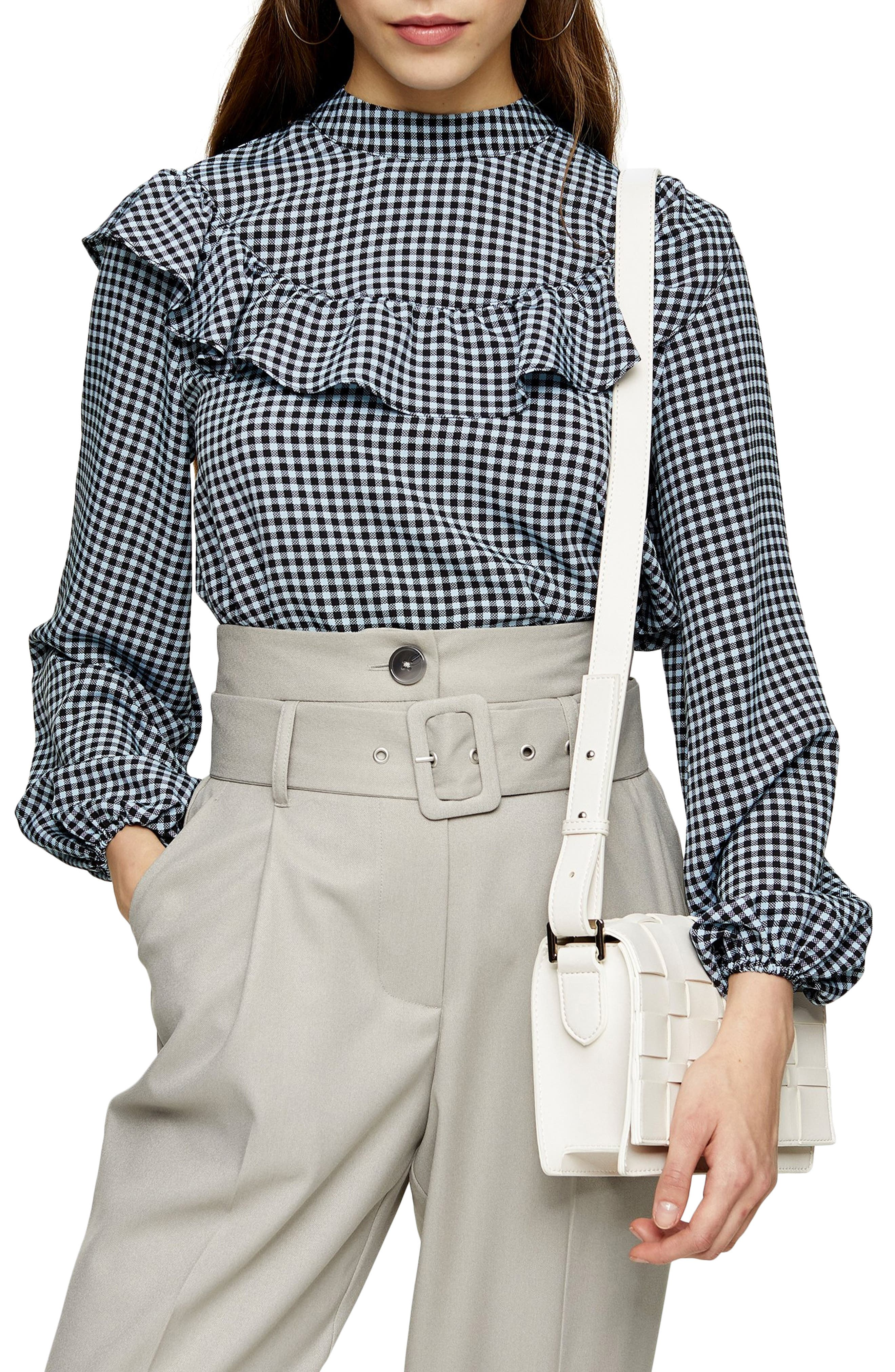 A soft ruffle frills the curved yoke of a vintage-inspired blouse patterned in fresh gingham checks. Style Name: Topshop Frill Yoke Gingham Blouse. Style Number: 6032033. Available in stores.
