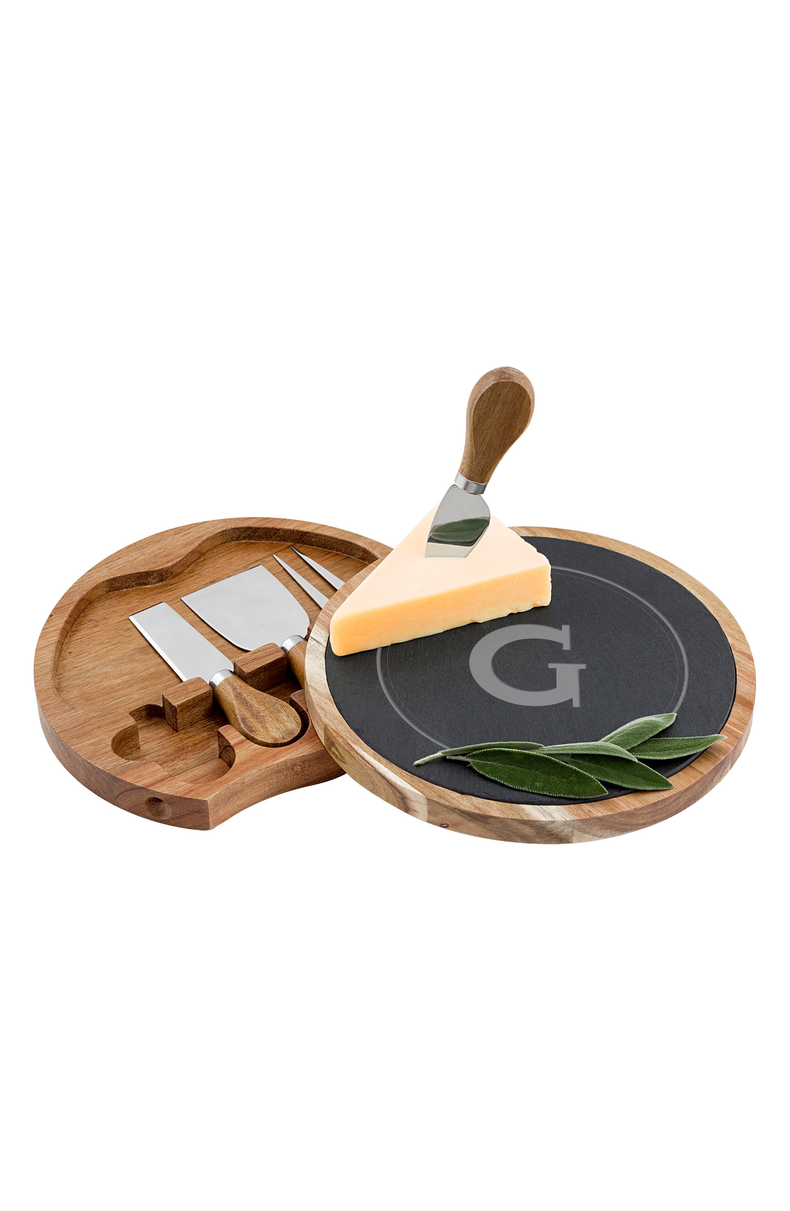 A perfectly portable cheese board crafted from acacia wood and natural slate makes an ideal wine-and-cheese party serving tray. It is made even better for picnics thanks to built-in storage for the accompanying cheese knife, shaver, fork and spreader. Style Name: Cathy\\\'s Concepts Monogram 5-Piece Cheese Board & Utensil Set. Style Number: 5641885. Available in stores.