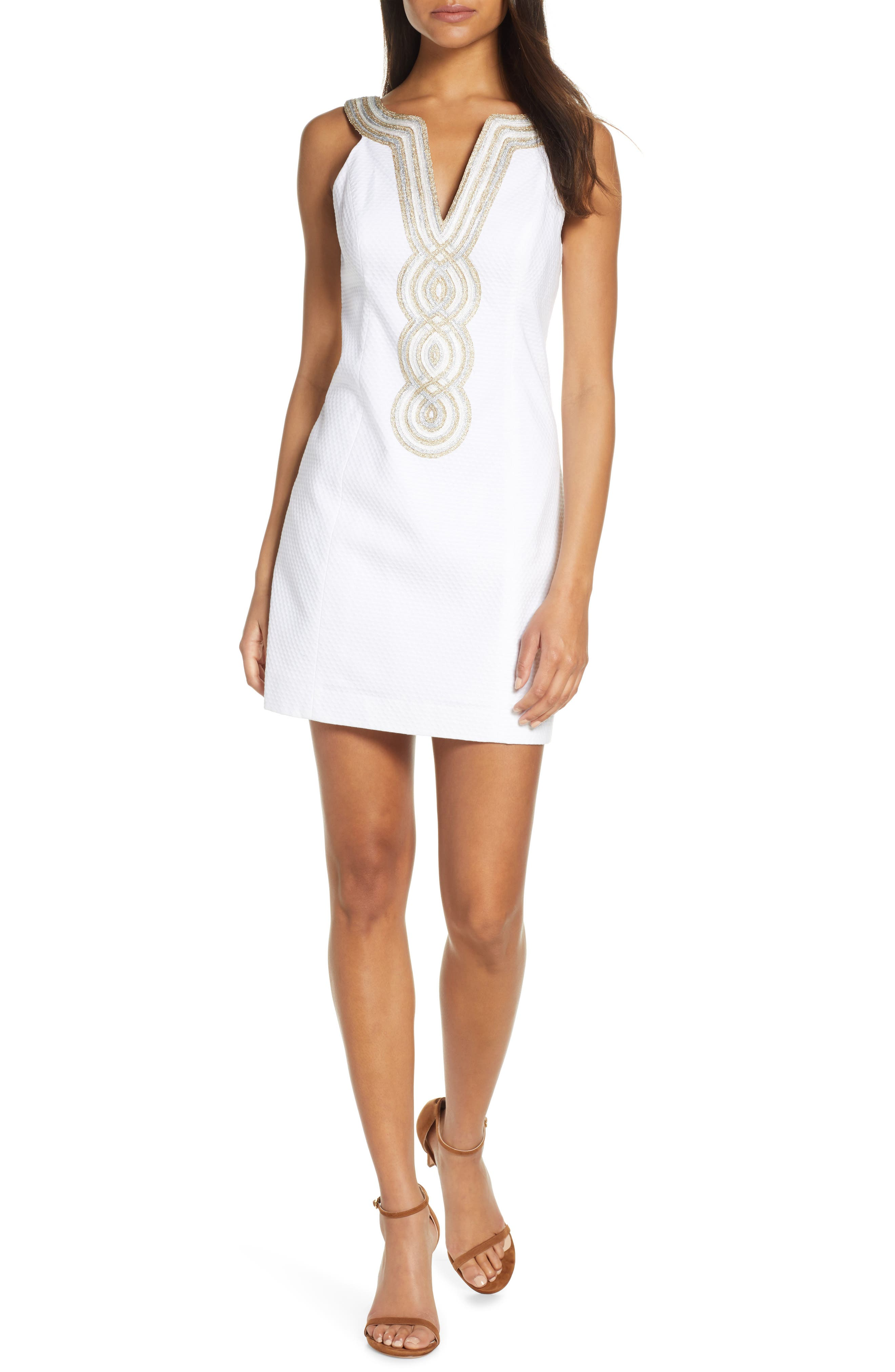Metallic silver and gold threads swirl their way up, down and around the split neckline of a classic sheath in a crisp cotton-pique fabric. Style Name: Lilly Pulitzer Valli Sheath Dress. Style Number: 5834670. Available in stores.