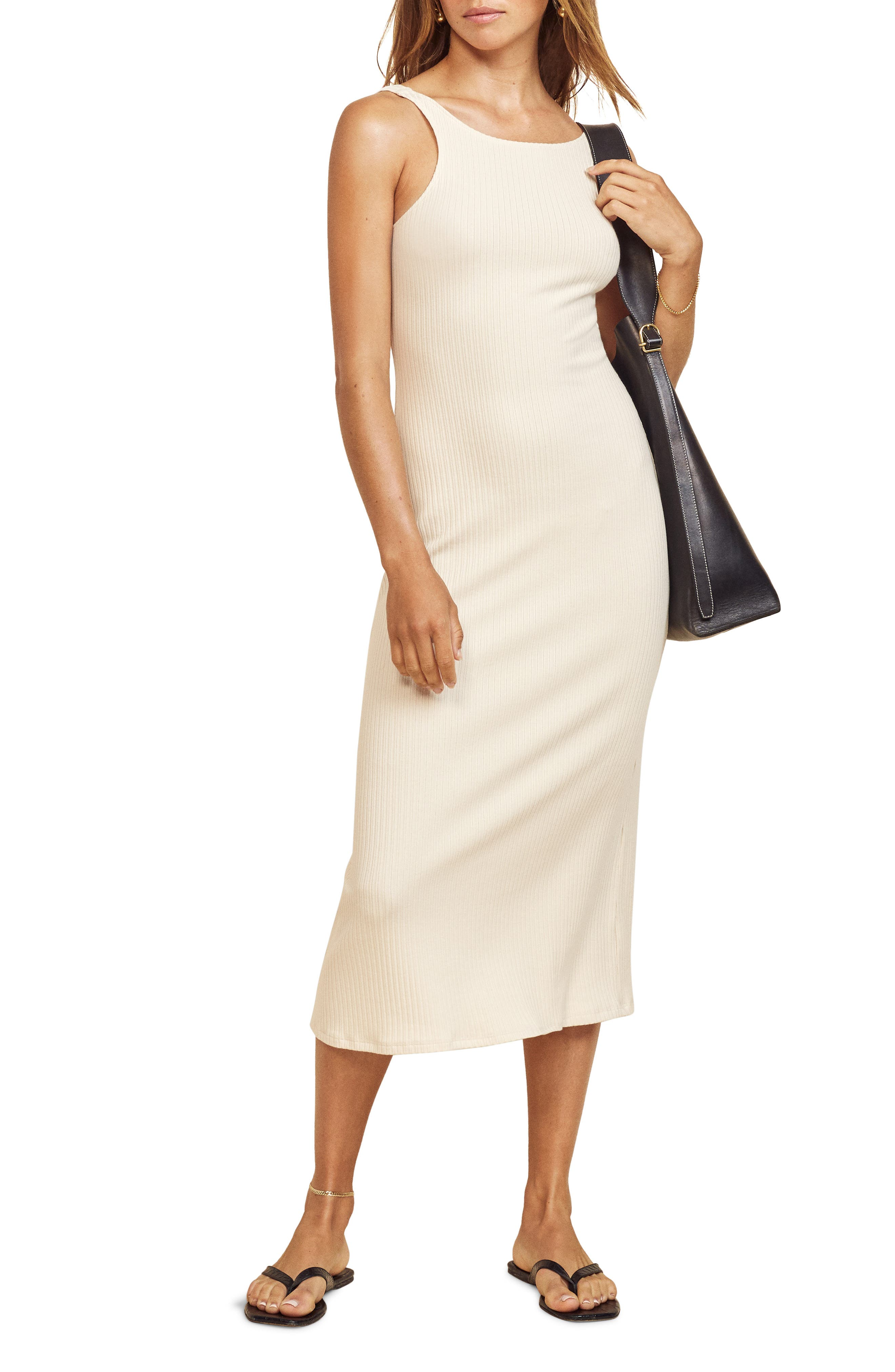 This neutral-hued knit dress is styled in a sleeveless silhouette and textured with soft ribbing for a shapely fit. Style Name: Reformation Bel Ribbed Sleeveless Midi Dress. Style Number: 6086408. Available in stores.