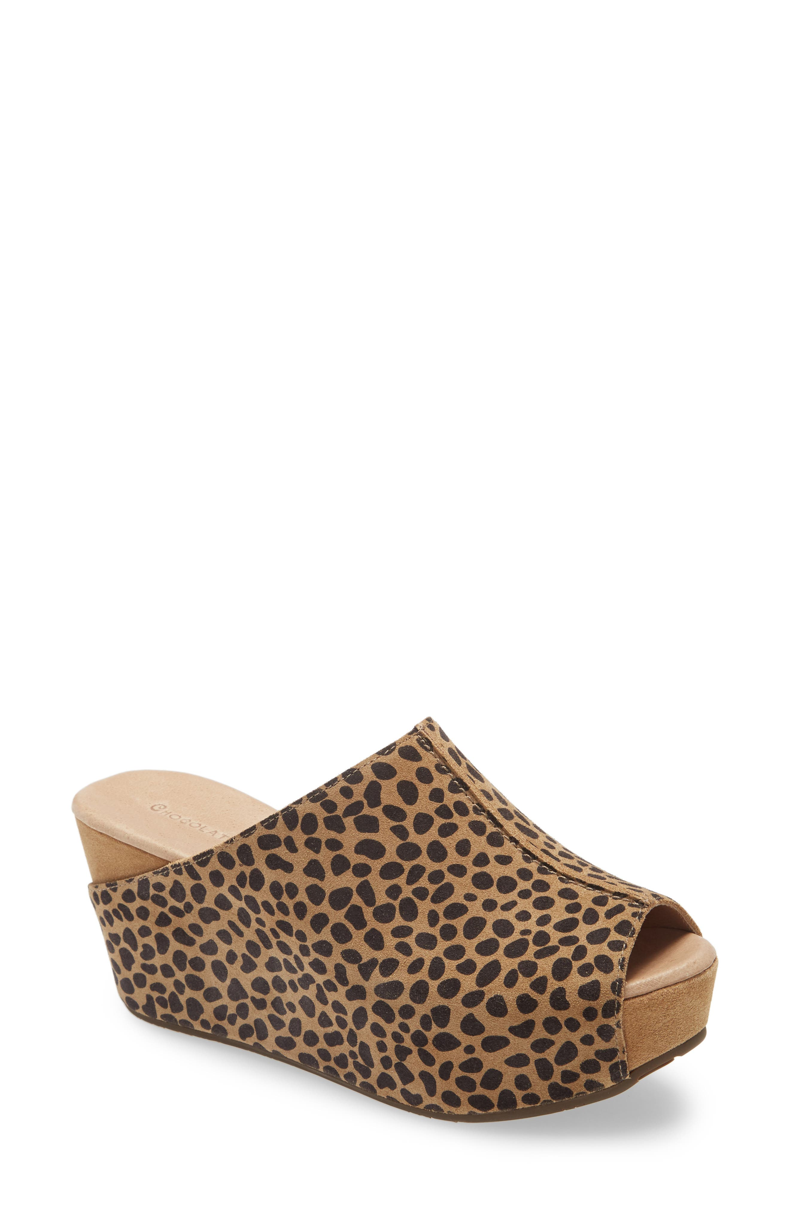 A wrapped wedge, chunky platform and reversed center seam pay homage to the \\\'70s-inspired influences of a decidedly modern mule. Style Name: Chocolat Blu Wynn Peep Toe Mule (Women). Style Number: 5356306. Available in stores.