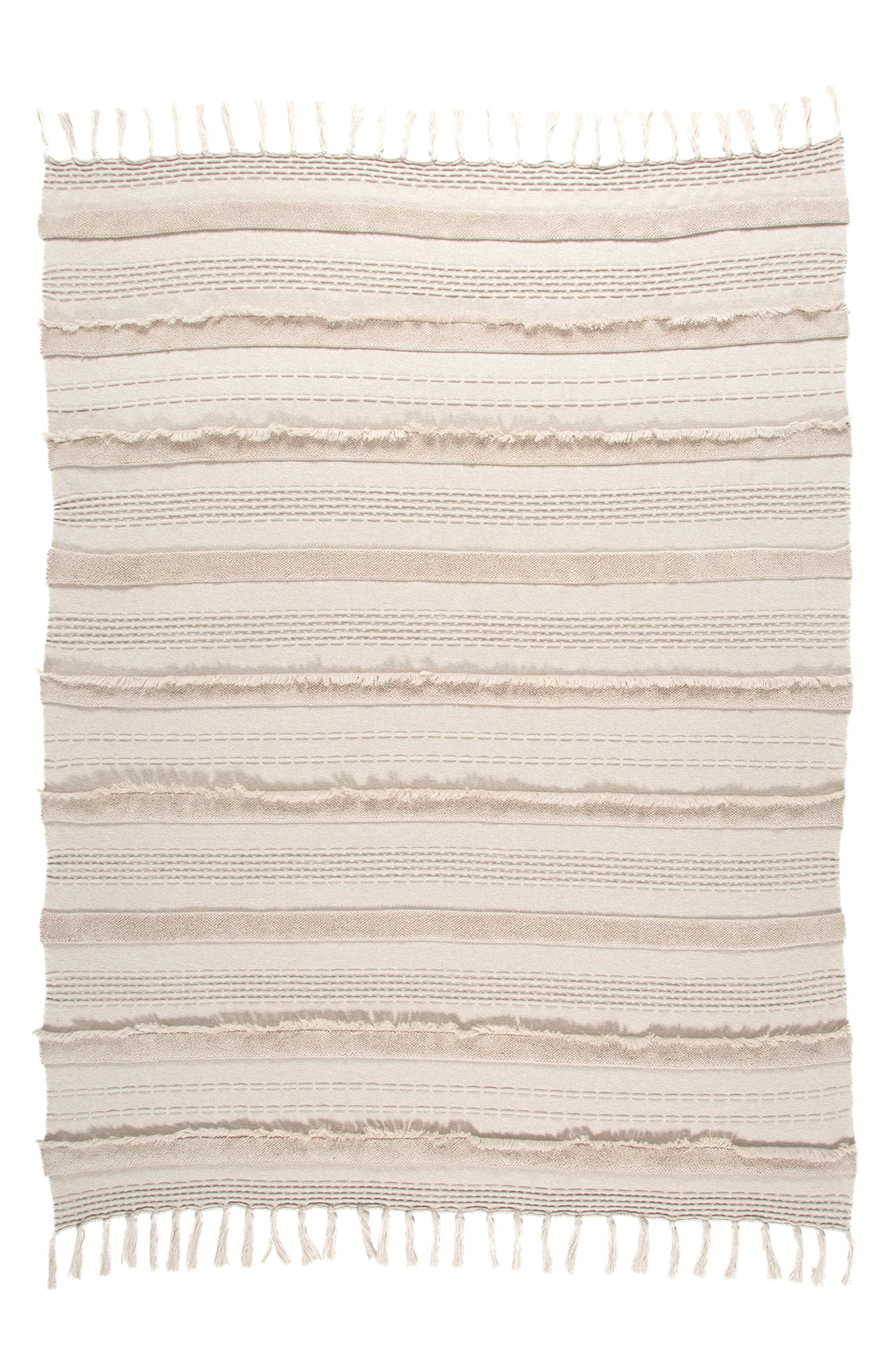 Tassel trim and tonal fringe add plenty of texture to this lightweight cotton blanket that complements any nursery decor. Style Name: Lorena Canals Fringe Knit Blanket. Style Number: 5869429. Available in stores.