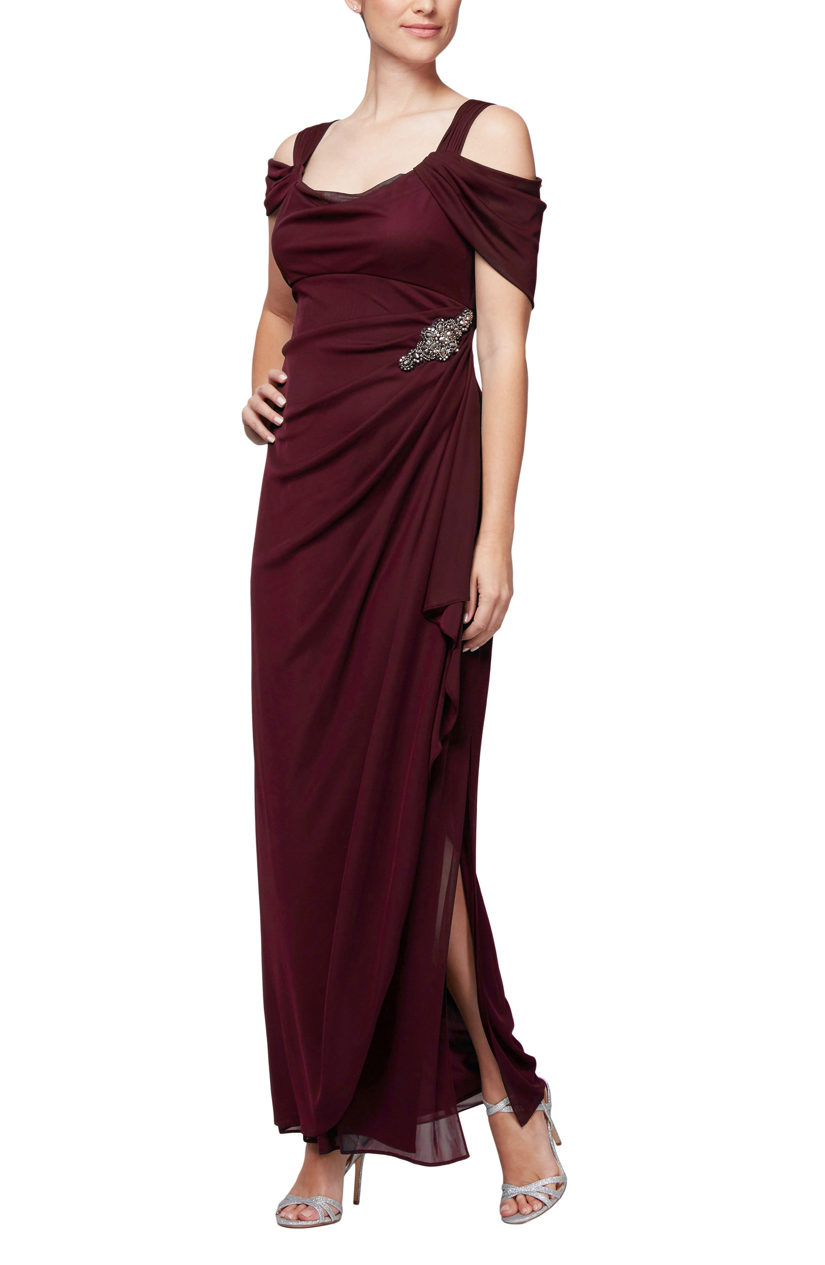Flatter your figure in this beautifully embellished gown styled with draped cold-shoulder sleeves and shapely ruching along one side. Style Name: Alex Evenings Embellished Cold Shoulder Column Gown. Style Number: 5620351. Available in stores.
