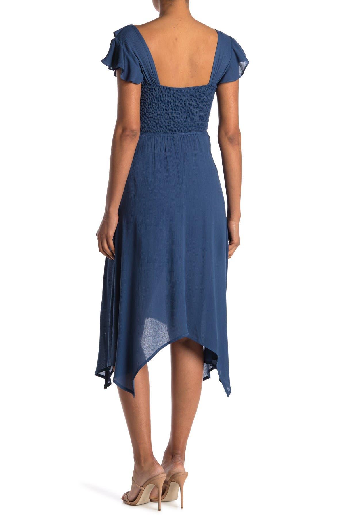 Image of KENEDIK Ruffled Handkerchief Hem Midi Dress