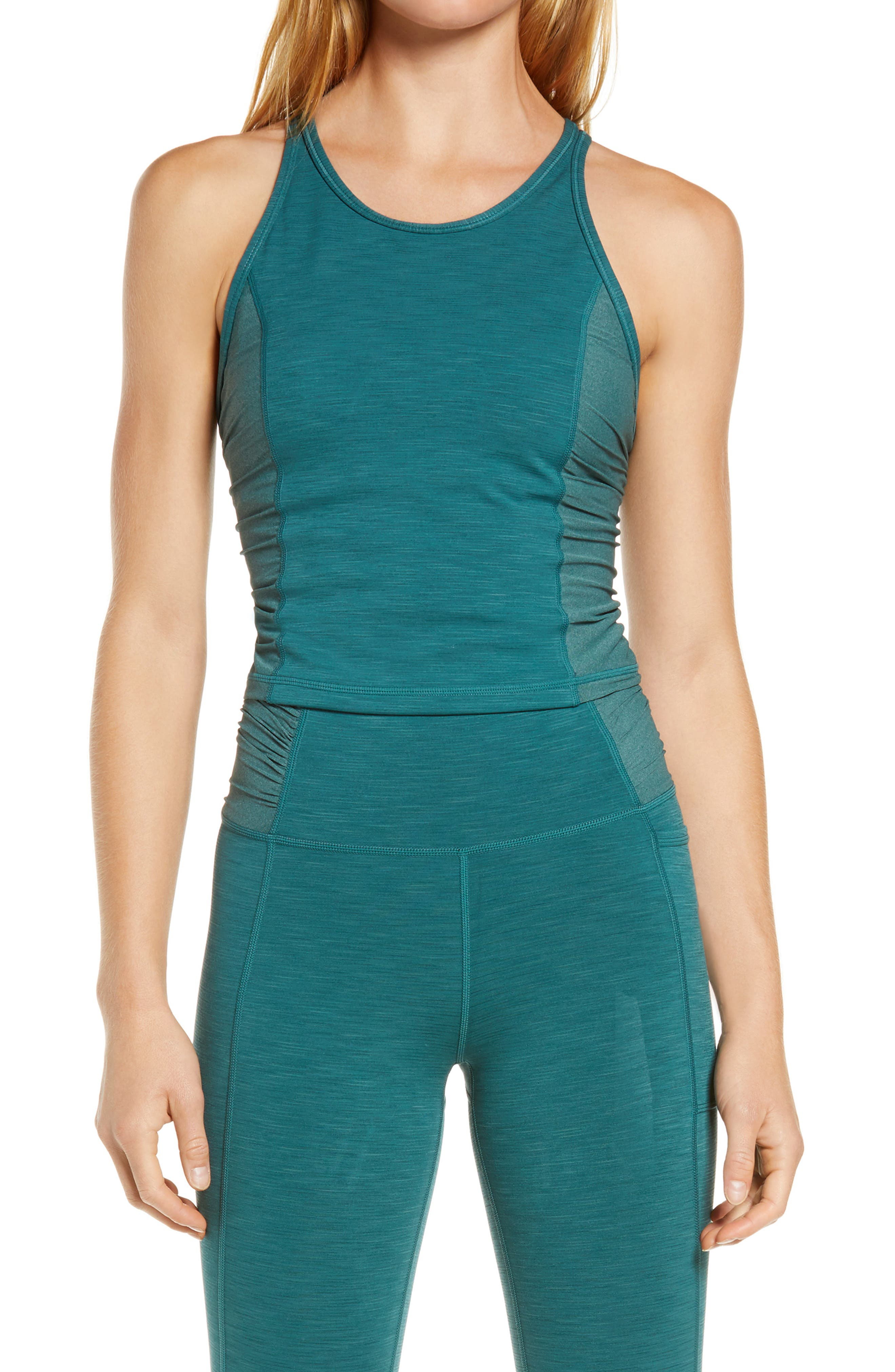 A tank cut from sculpting, sweat-wicking fabric has a strappy back for full-range motion and softly gathered sides of mesh for breathable comfort. Style Name: Sweaty Betty Super Sculpt Mesh Yoga Tank. Style Number: 6091352. Available in stores.