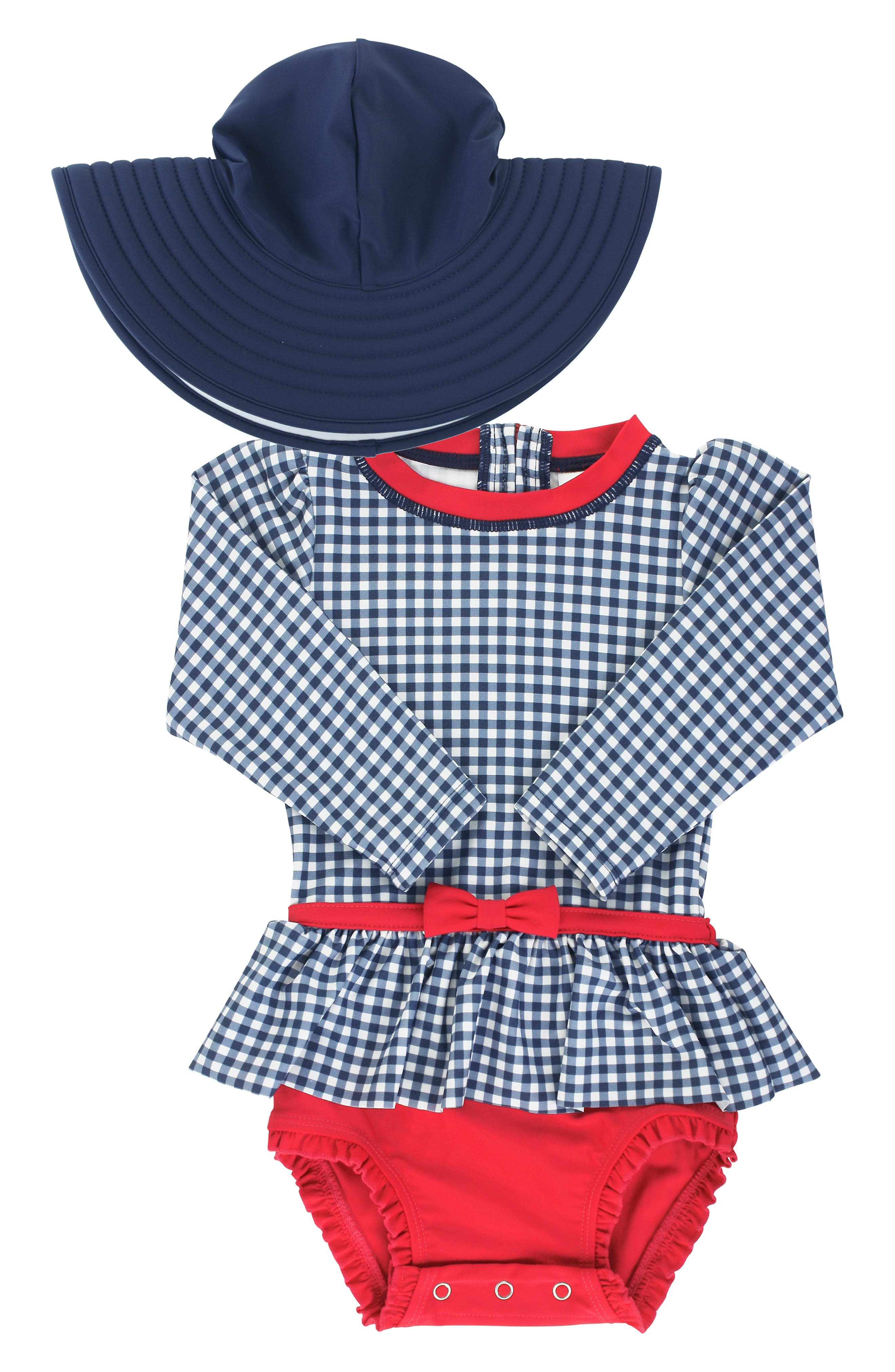 Gingham checks, pops of red and a cute peplum make this one-piece swimsuit a beachy fave, while the matching floppy hat provides extra sun protection. Style Name: Rufflebutts Skirted One-Piece Rashguard Swimsuit & Reversible Floppy Hat Set (Baby). Style Number: 5938577. Available in stores.