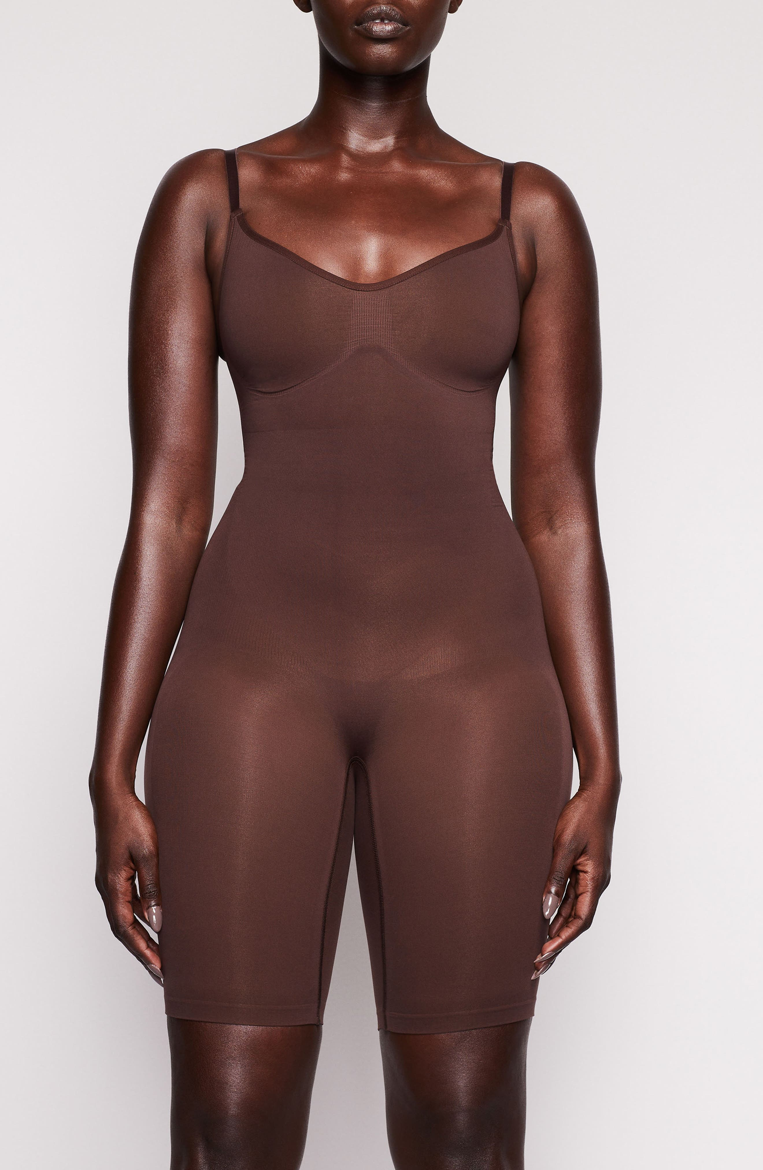 Sculpt your body\\\'s natural shape with a bodysuit from Kim Kardashian West\\\'s SKIMS that holds in your core, lifts your butt and supports your chest. Reflecting the brand\\\'s passion for highly technical shapewear solutions for every body, this mid-thigh piece has a whisper-soft, seamless construction and comes in nine different shades to complement your skintone. Style Name: Skims Sculpting Seamless Mid-Thigh Bodysuit (Regular & Plus Size). Style
