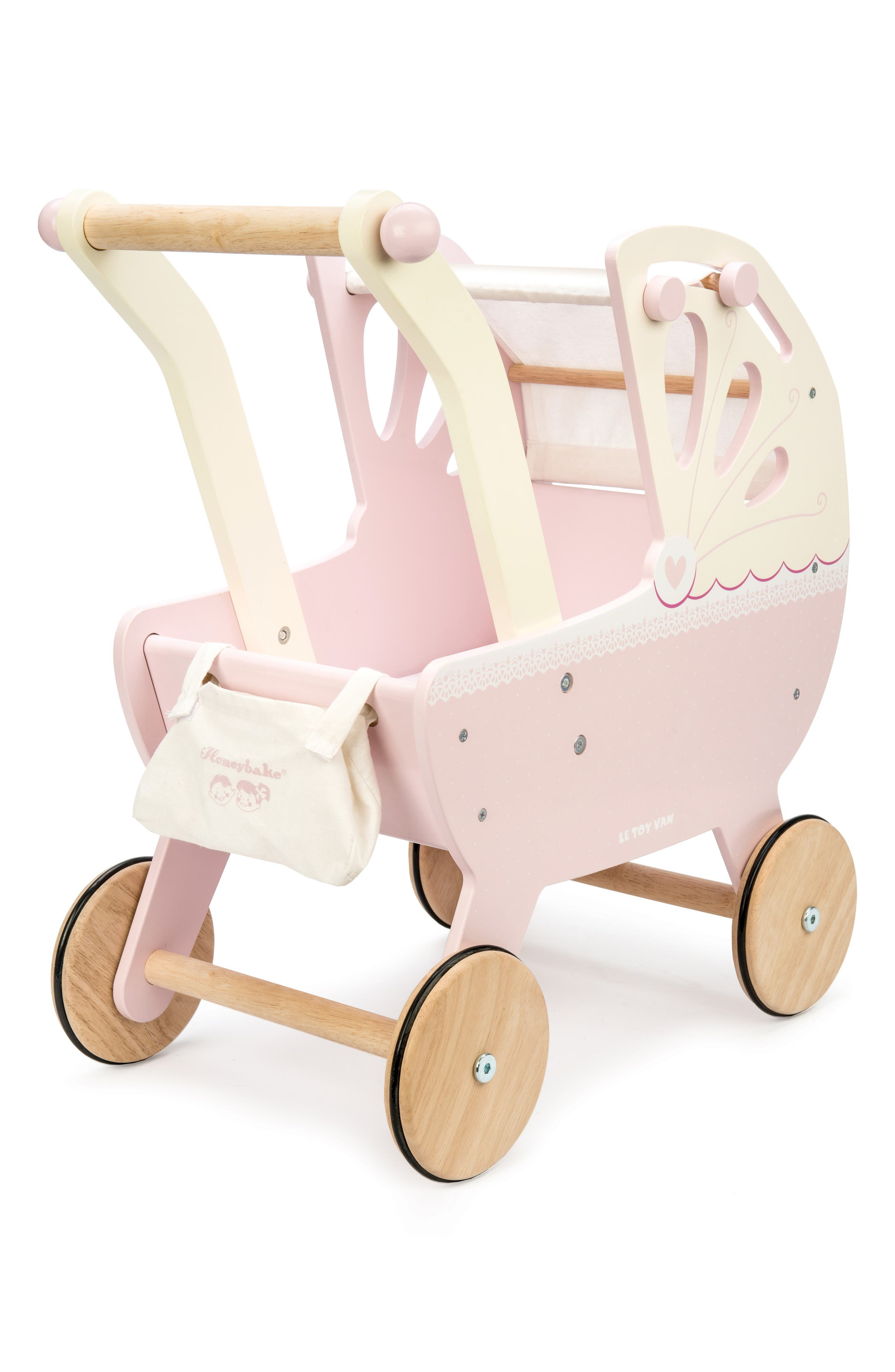 Adorned with charming hearts and fanciful lace-inspired details, a classic pram is perfect for strolling with either dolls or stuffed animals in tow. Style Name: Le Toy Van Sweet Dreams Pram. Style Number: 6124947. Available in stores.