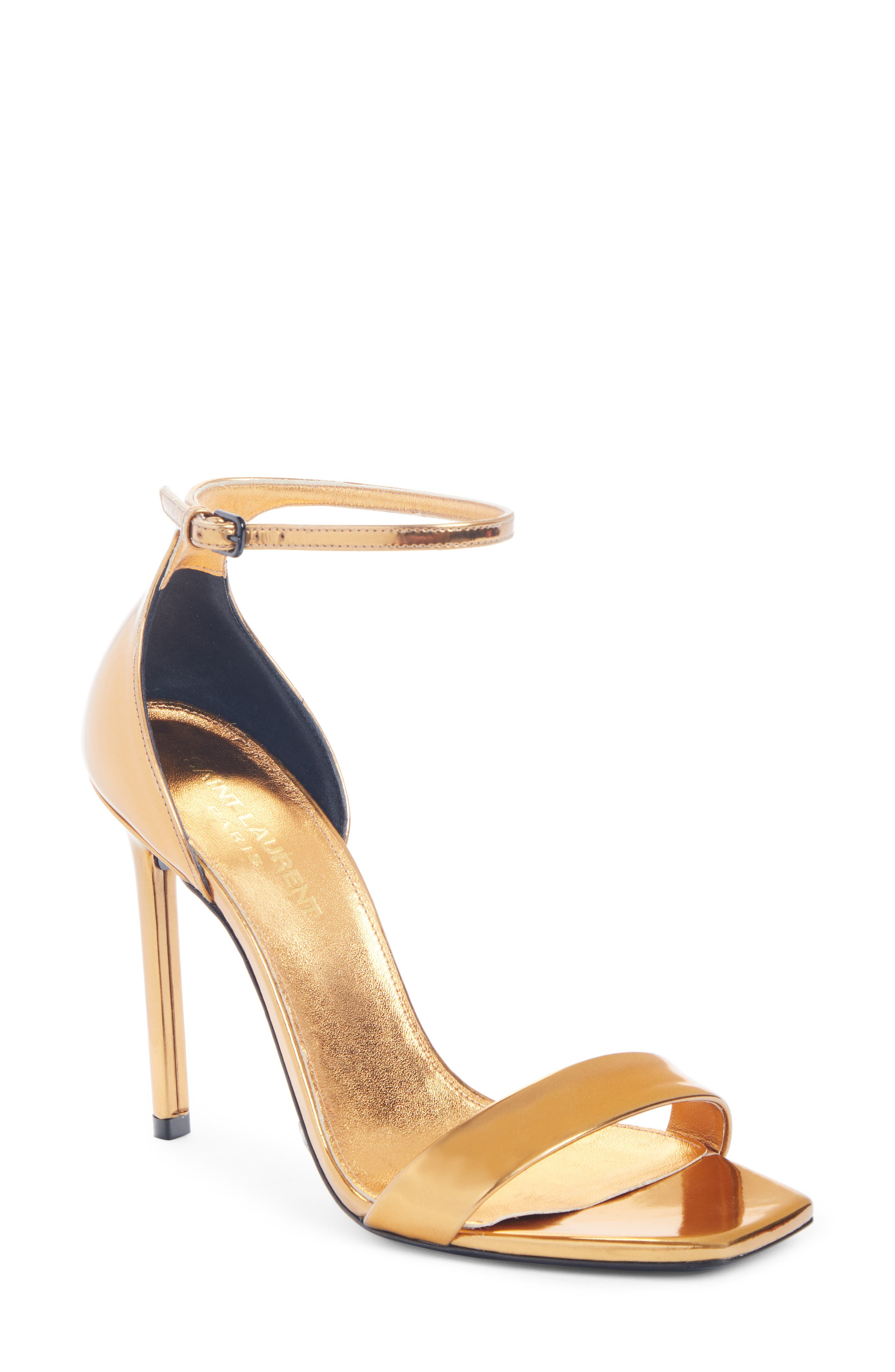 A sharply blunted toe and a slender, curvy halo strap frame a sandal done in metallic polish with a towering stiletto providing formidable lift. Style Name: Saint Laurent Amber Metallic Sandal (Women). Style Number: 5952506 1. Available in stores.