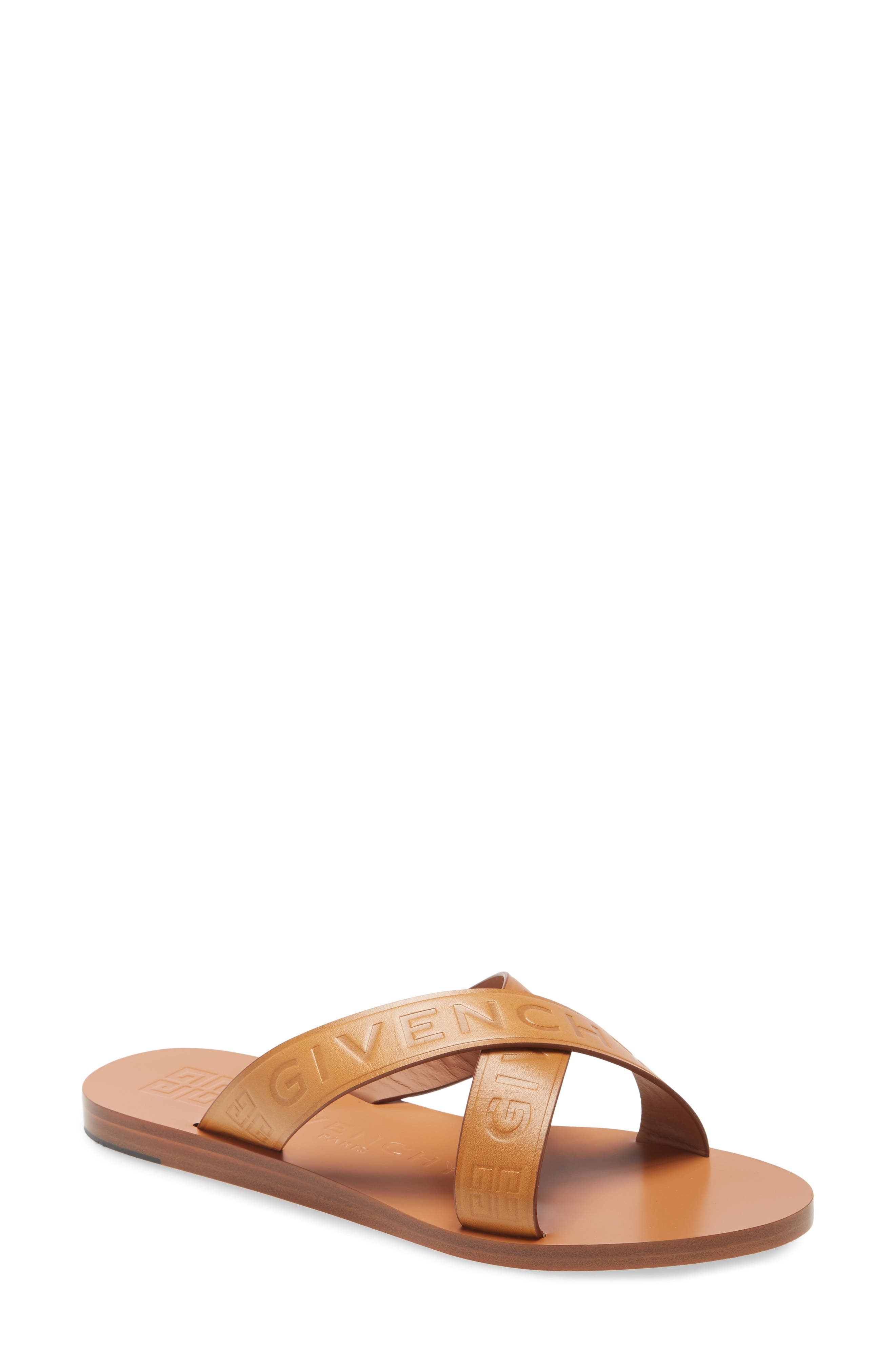 Pre-order this style today! Add to Shopping Bag to view approximate ship date. You\\\'ll be charged only when your item ships. Givenchy offers laid-back luxury with this vegetable-tanned Italian-leather sandal branded with logo debossing along the crisscrossed straps and footbed. Style Name: Givenchy 4G Logo Crisscross Slide Sandal (Women). Style Number: 6069440. Available in stores.