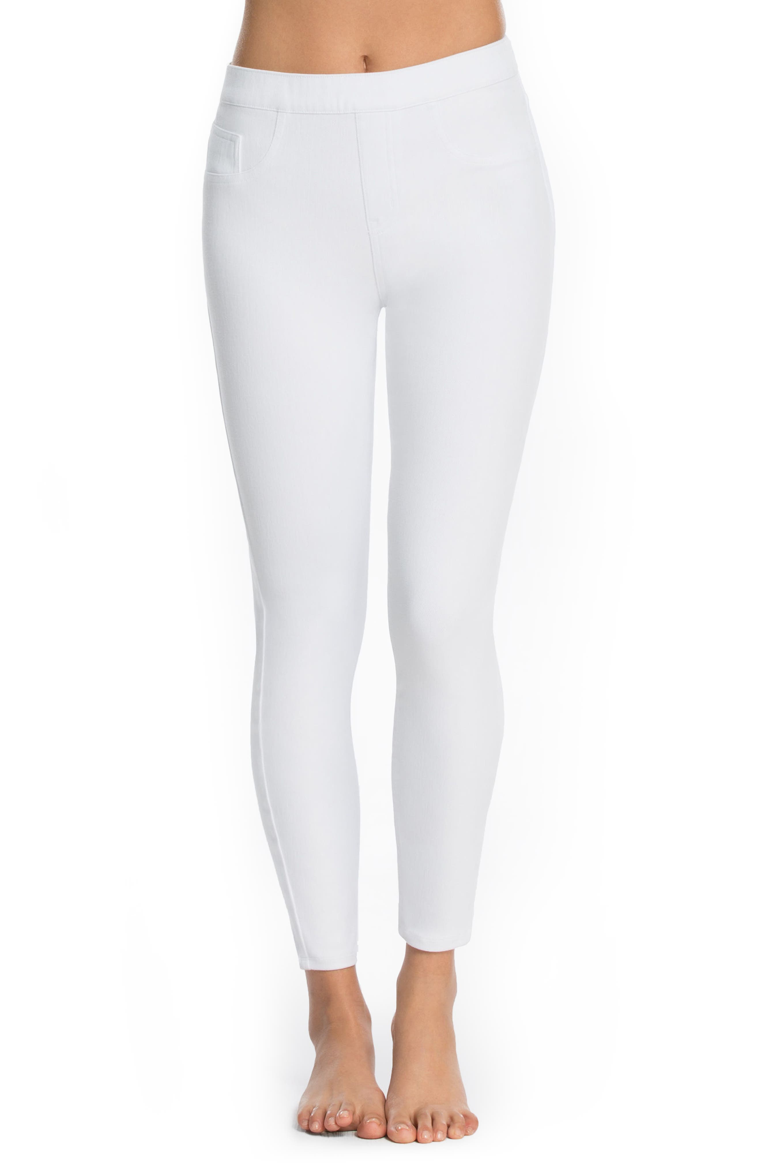 The power of SPANX shapers teams up with the look of skinny jeans in these leggings crafted with a comfy elastic waist, flattering back pockets and hems that hit right at the ankles. Style Name: Spanx Jean-Ish Leggings. Style Number: 5090147. Available in stores.