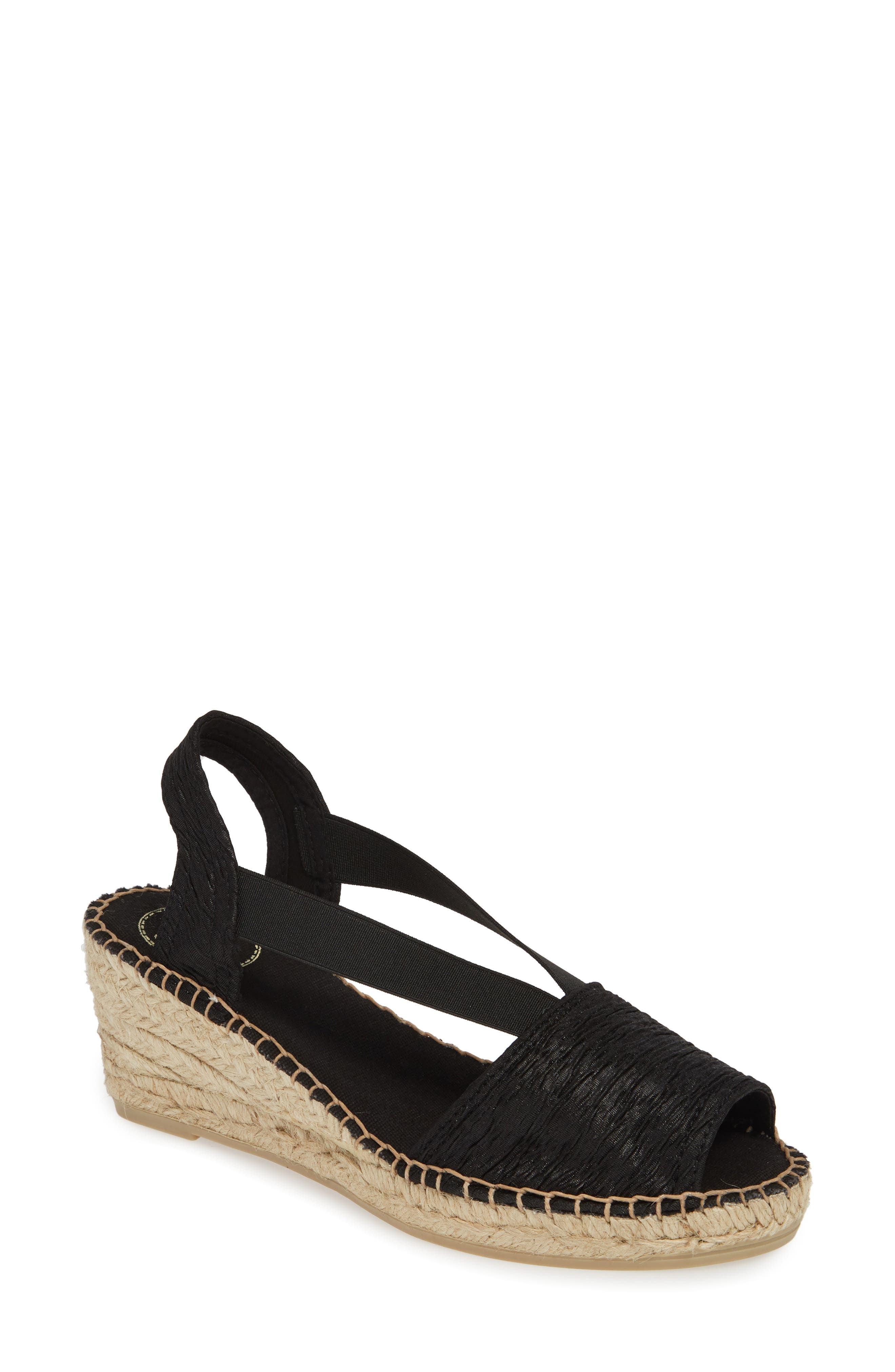 Get in the sun-chasing spirit in this espadrille-style sandal with stretch straps tethering the rustic woven upper and braided jute wrapping the wedge. Style Name: Toni Pons Taga Sandal (Women). Style Number: 5804129. Available in stores.