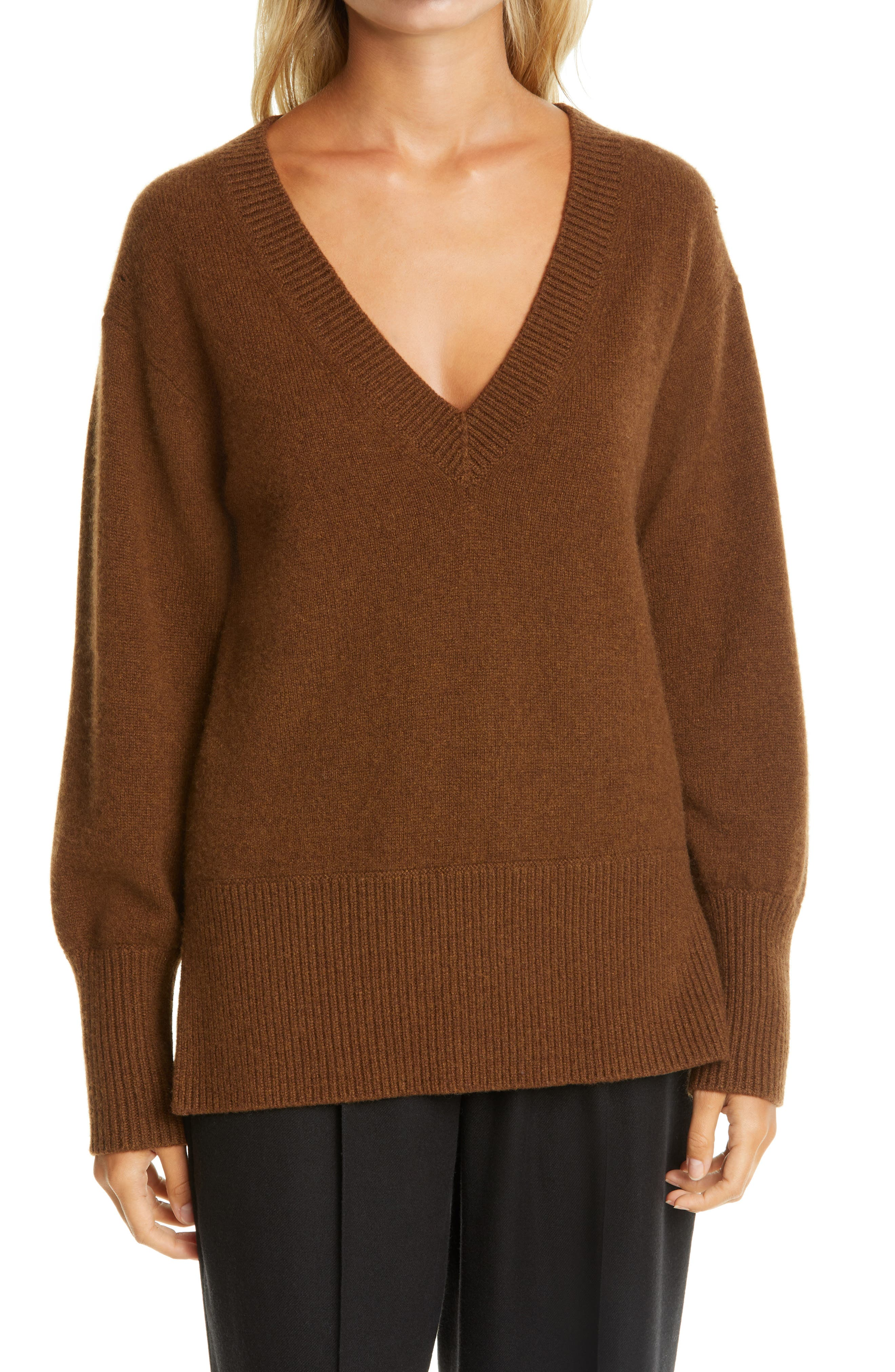 A ribbed V-neck, hem and cuffs trim an oversized cashmere sweater with a split hem for easy movement. Style Name: Vince Ribbed V-Neck Cashmere Tunic Sweater. Style Number: 6055826. Available in stores.