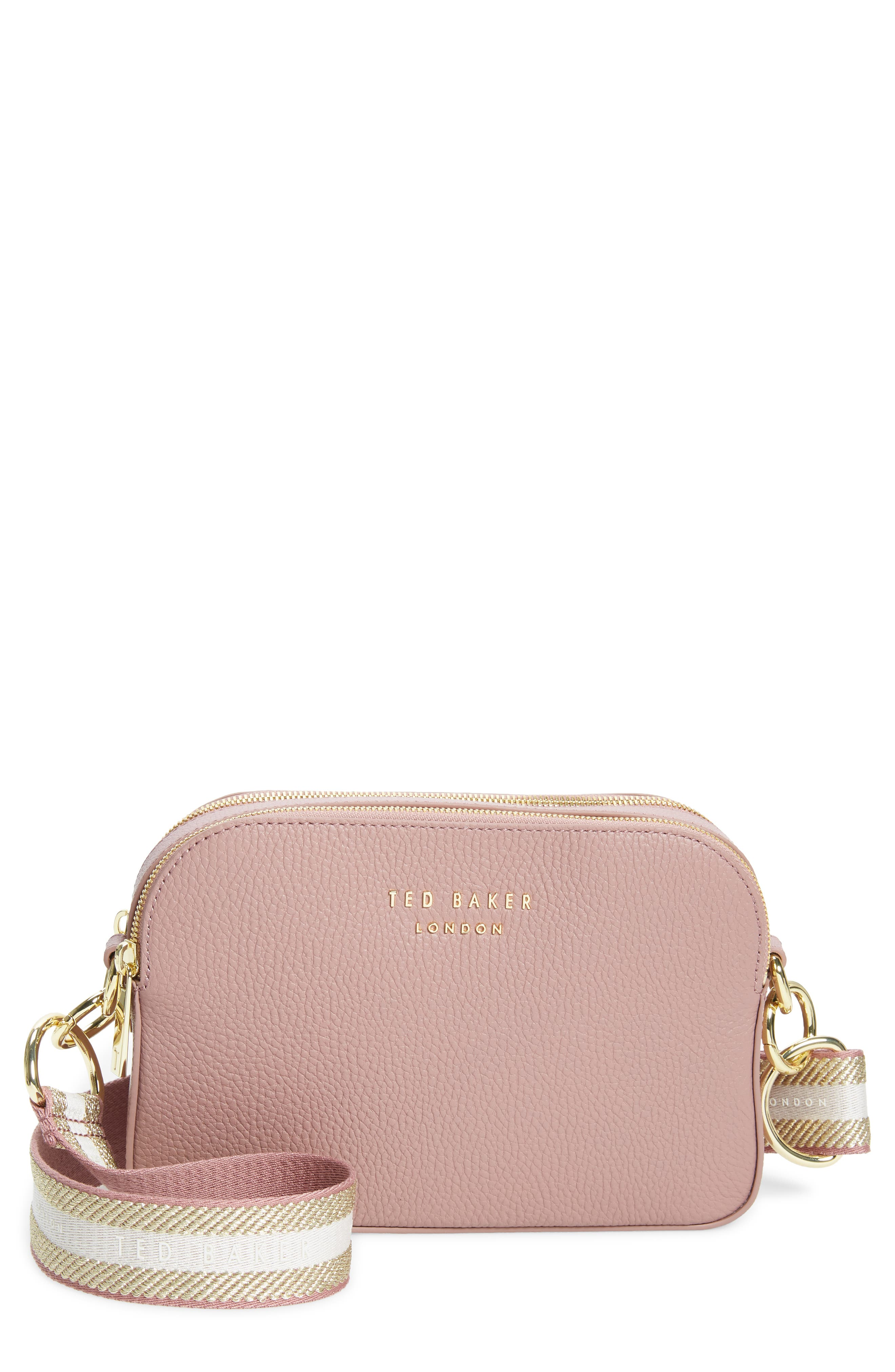 This grainy leather bag lets you mix it up thanks to its two straps, one a traditional leather one and the other a bold webbed strap with stripes and logos. Style Name: Ted Baker London Amerrah Branded Strap Leather Crossbody Bag. Style Number: 5997137. Available in stores.