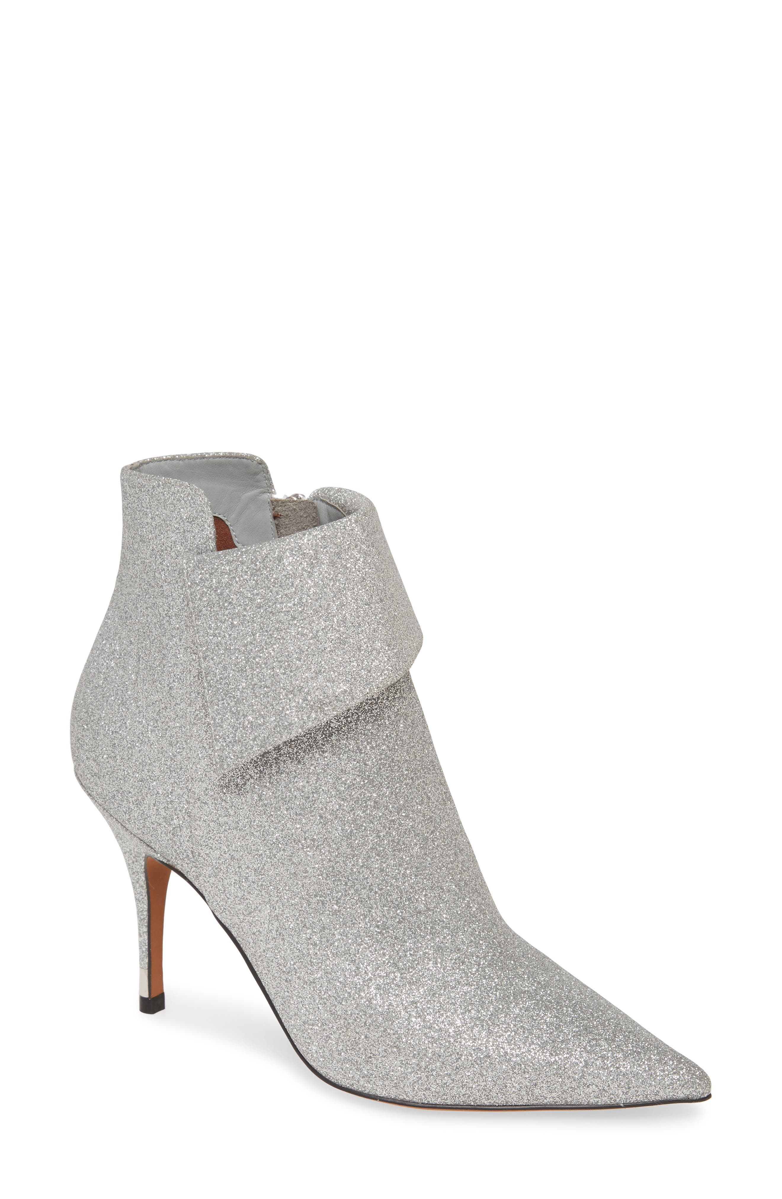 An angled fold-down cuff elevates the fashion-forward look of a shimmering pointy-toe bootie lifted by a gilt-accented slim heel. Style Name: Linea Paolo North Bootie (Women). Style Number: 5918327. Available in stores.