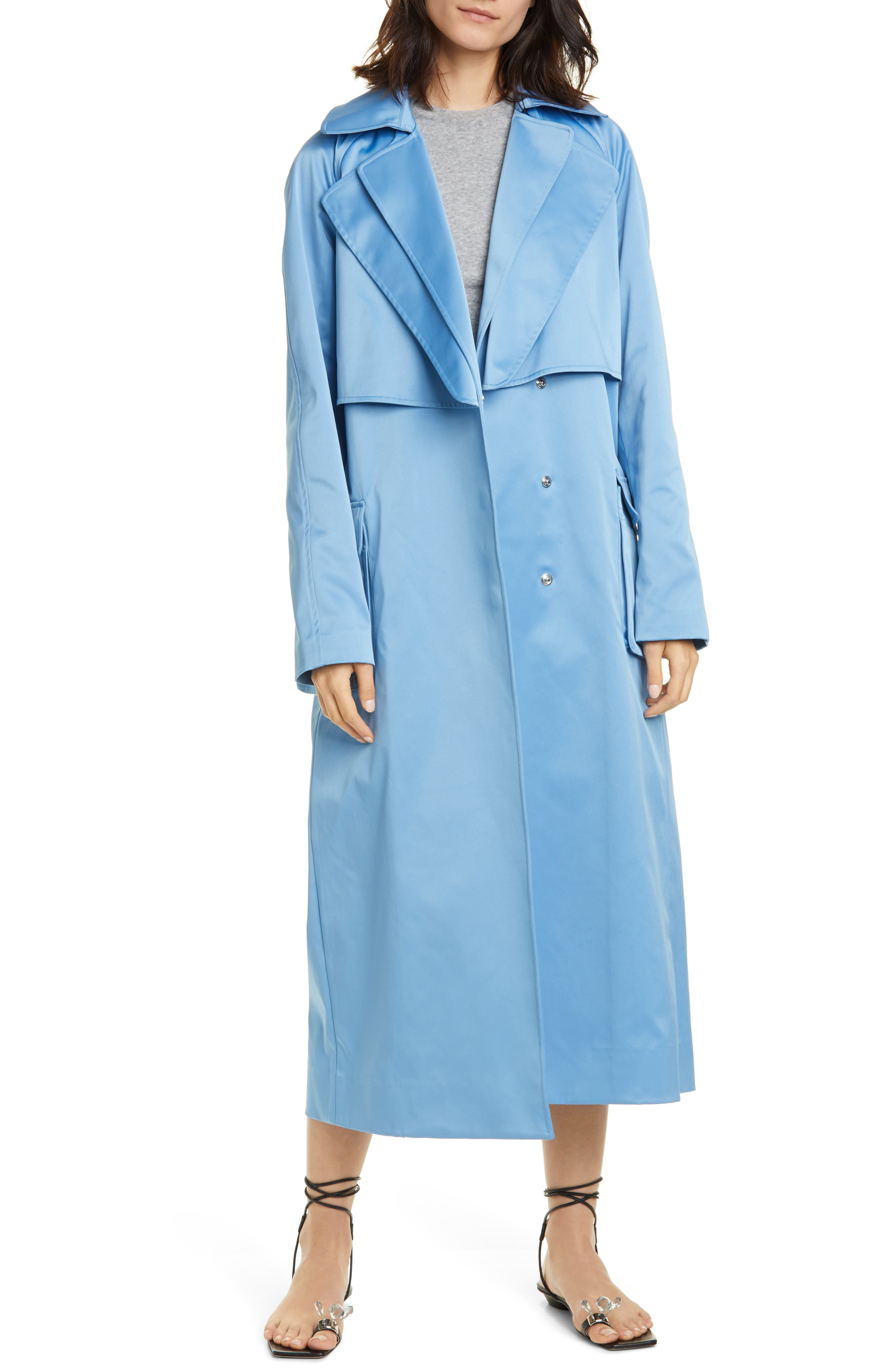Signature doubled lapels detail an Italian-duchesse satin trench in a lovely sky-blue color perfect for pairing with your fresh-for-the-season wardrobe. Style Name: Tibi Duchesse Tech Satin Trench Coat. Style Number: 5991842. Available in stores.