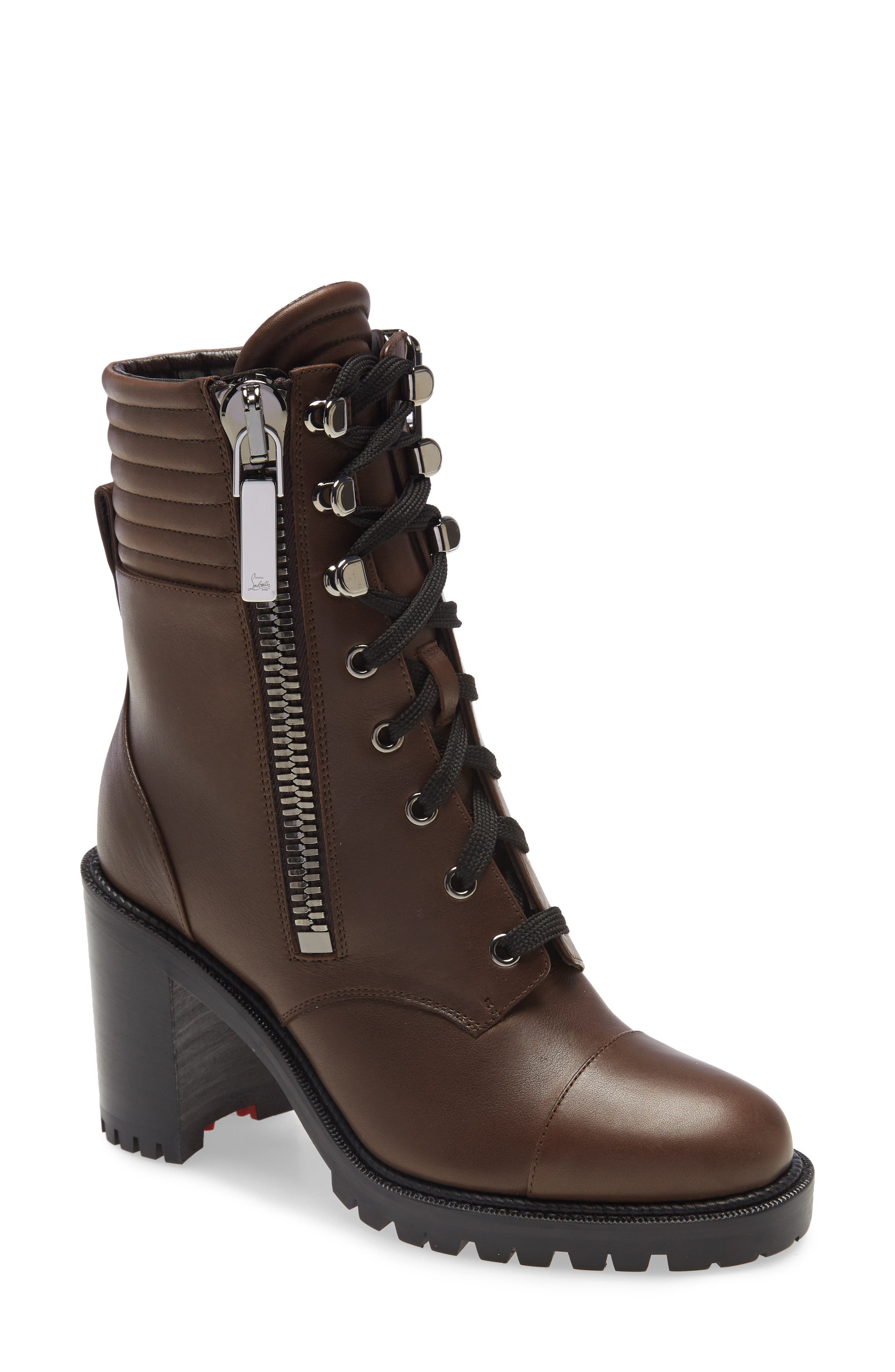 Designed with lacing hooks, a quilted cuff and reinforced cap toe, this heeled leather hiking boot may be trail inspired, but it\\\'s city bound. Christian Louboutin\\\'s iconic red sole gets a rugged reboot as an inset in the lugged tread. Style Name: Christian Louboutin En Hiver Hiking Boot (Women). Style Number: 6046864. Available in stores.