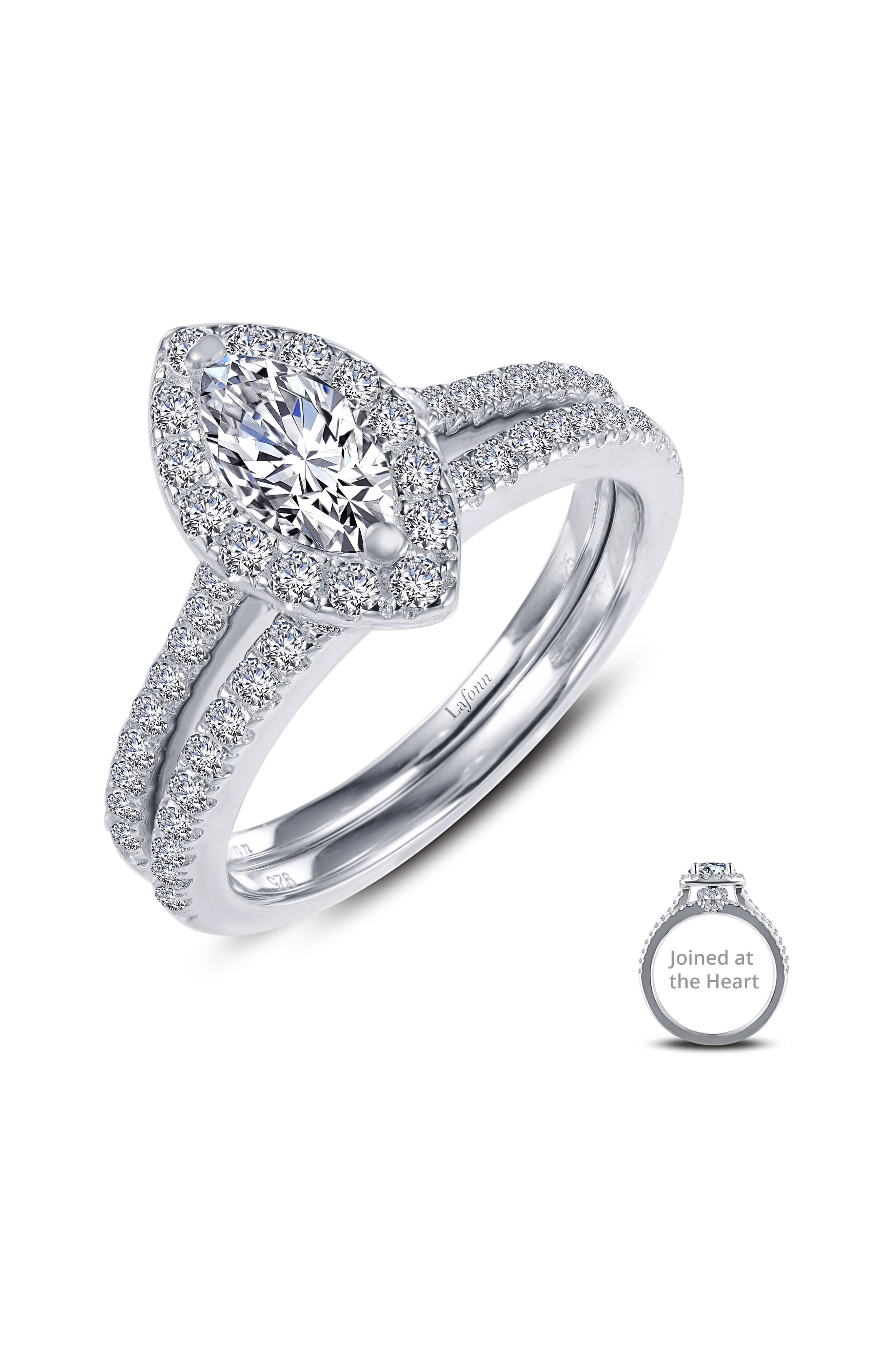 A timeless set combining engagement ring and wedding band forms a dazzling heart, signifying the beauty of your union. The engagement ring boasts a sparkly marquise-cut stone and the wedding band is styled with more of Lafonn\\\'s signature Lassaire simulated diamonds for truly stunning allure. Style Name: Lafonn Joined At The Heart Marquise Halo Ring. Style Number: 5627079. Available in stores.
