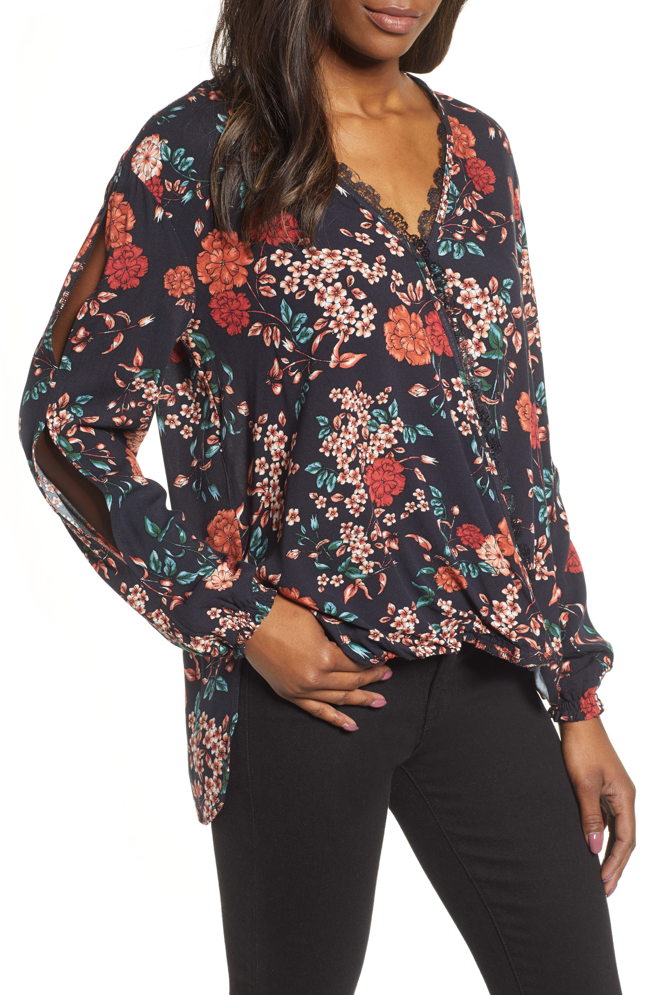 If the plans are hot you\\\'ll definitely want this top\\\'s built-in cool thanks to the slits down the sleeves and the lace trimming the faux wrap front. Style Name: Wit & Wisdom Slit Sleeve Blouse (Nordstrom Exclusive). Style Number: 5706230. Available in stores.