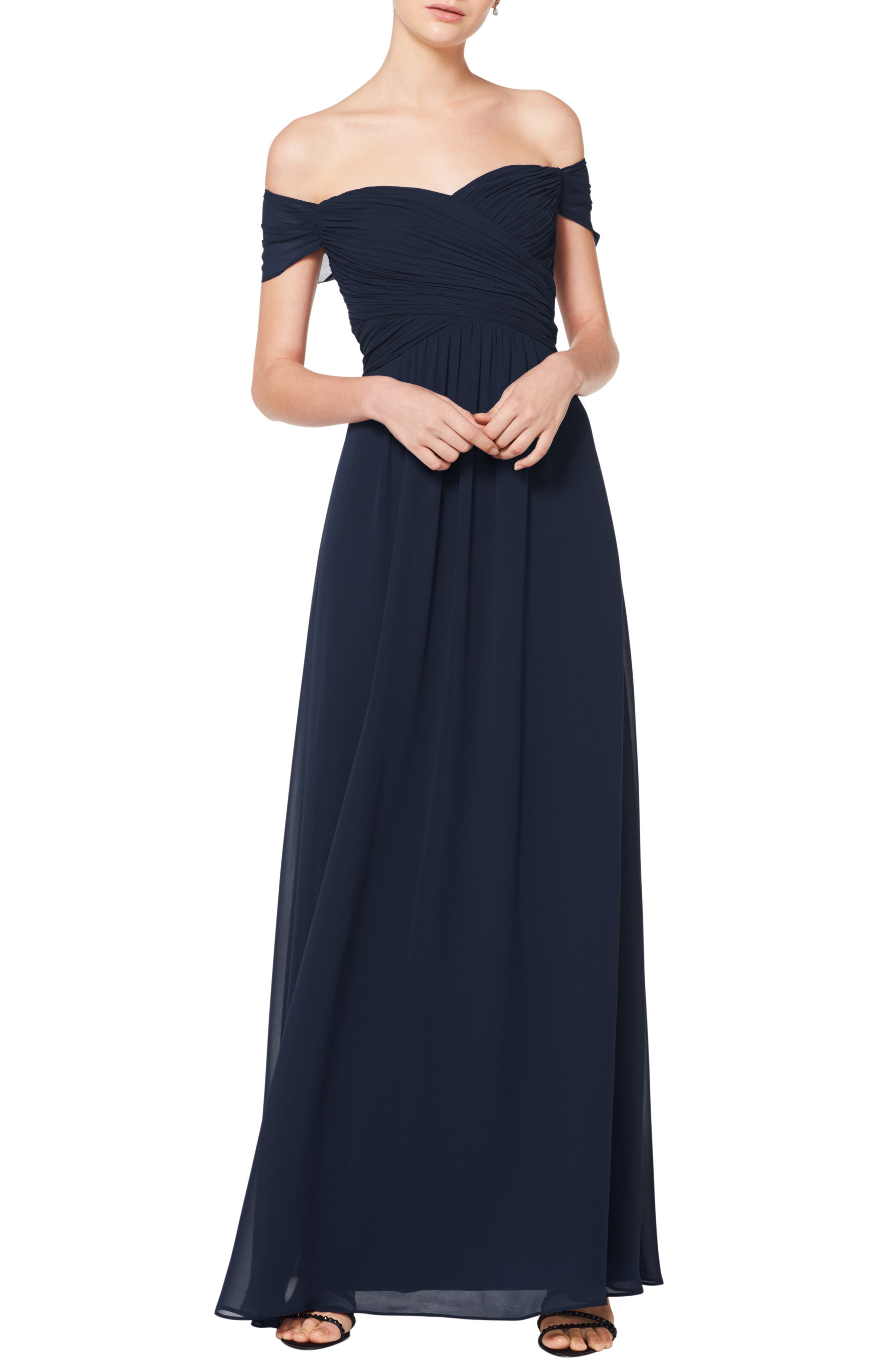Simply romantic, with slender pleats and flowing chiffon, this shoulder-baring gown looks effortlessly elegant-because it is. The A-line silhouette makes the dress effortlessly flattering and perfect for bridesmaids or wearing to a formal event. Style Name:#levkoff Off The Shoulder Chiffon A-Line Gown. Style Number: 5774986. Available in stores.