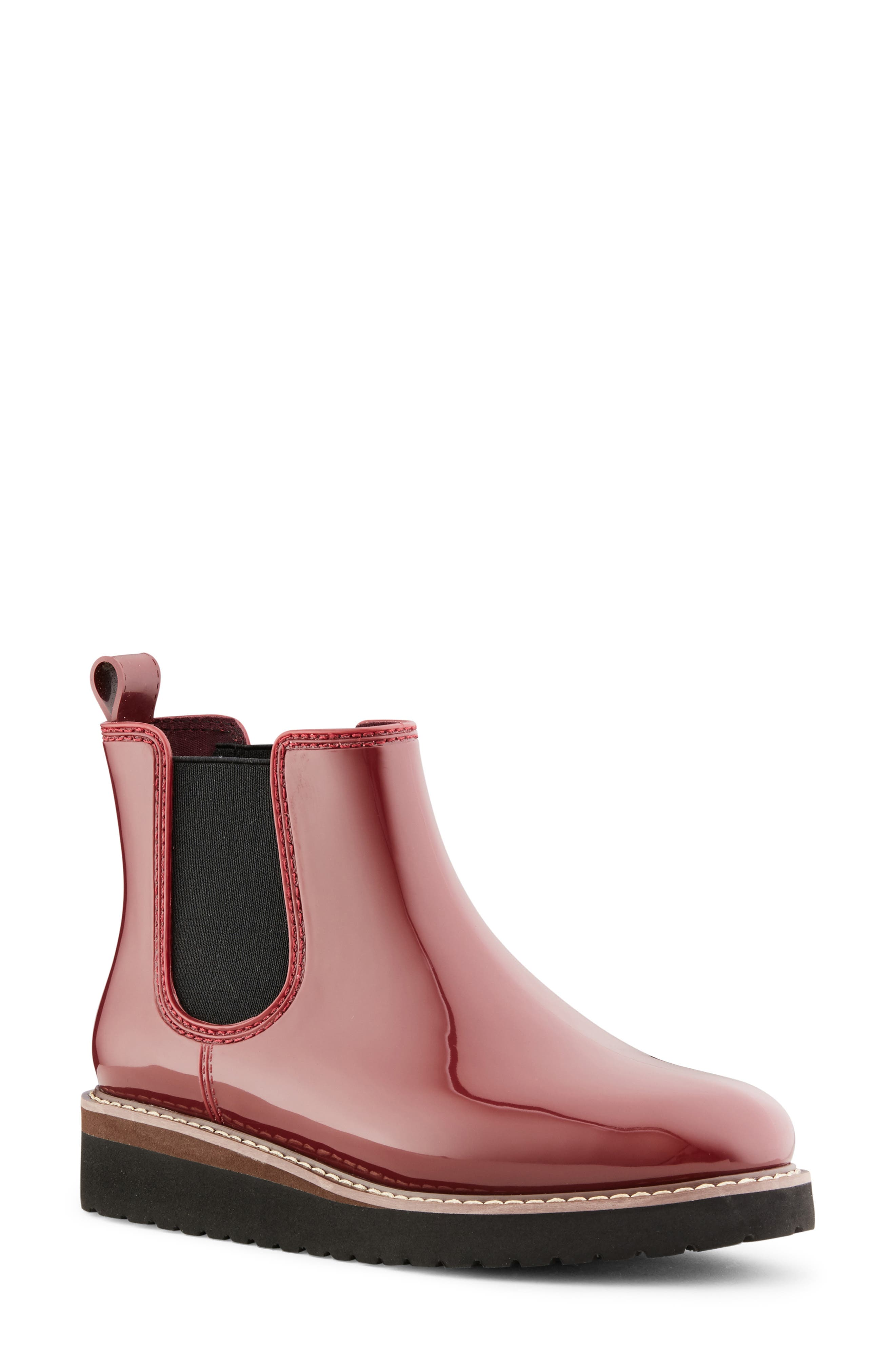 A splash-proof rain boot in an easy-on Chelsea silhouette is patterned in flowers and finished with anti-slip treads. Style Name: Cougar Kensington Chelsea Rain Boot (Women). Style Number: 5550733. Available in stores.