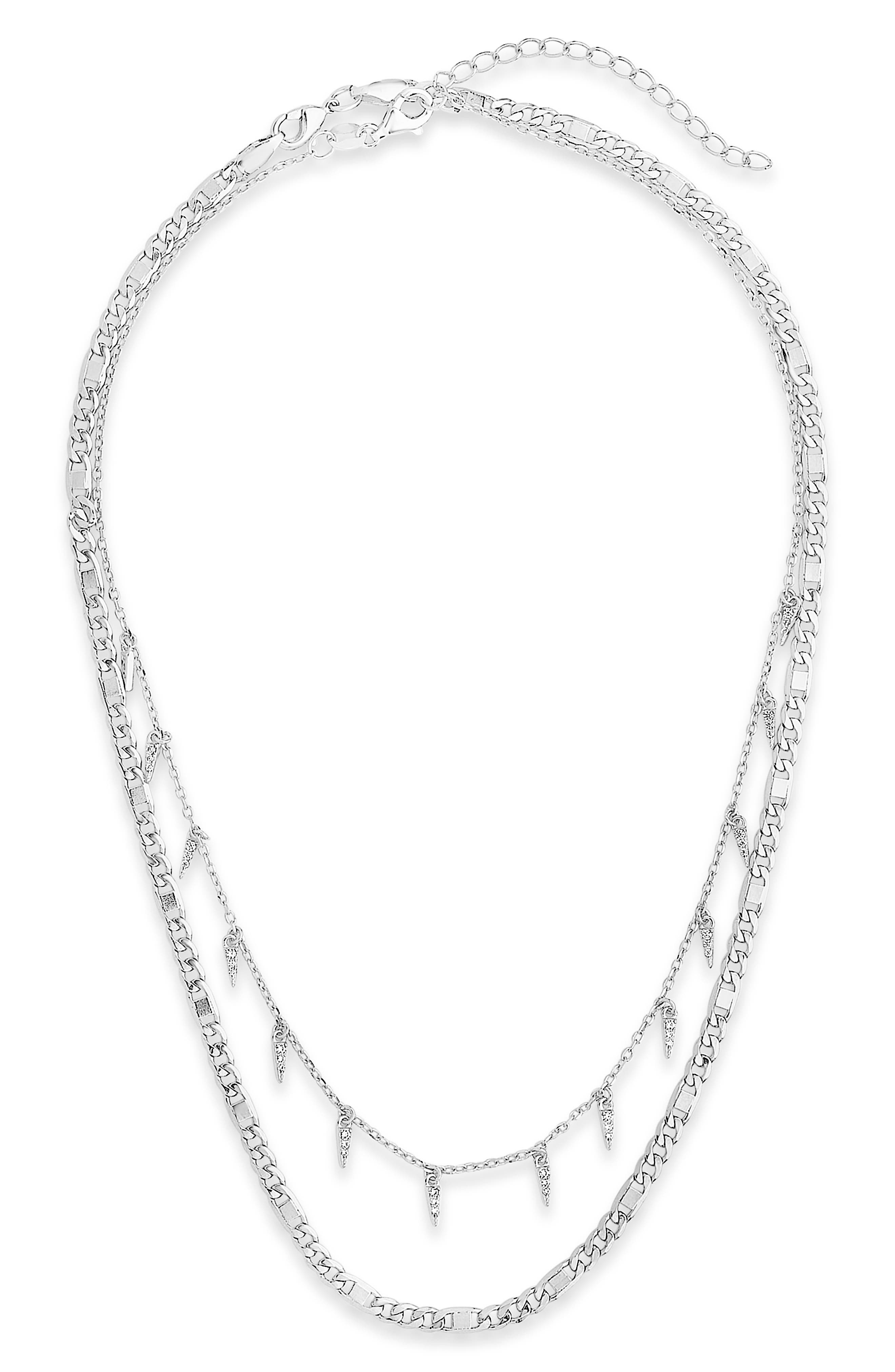 Nail the layered look in this two-strand necklace featuring simple figaro links and a shorter chain embellished with crystal-adorned pyramid pendants. Style Name: Sterling Forever Cubic Zirconia Layered Necklace. Style Number: 6173959. Available in stores.