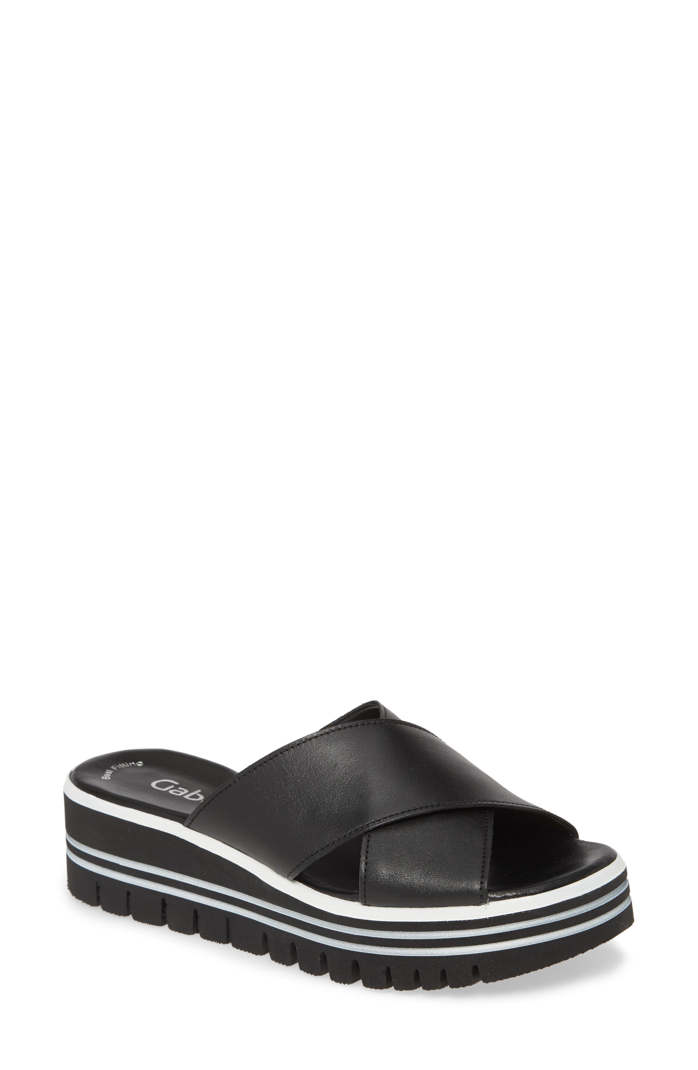 Wide crisscross straps define a casual-chic slide sandal elevated by a chunky lugged platform with a striking layered look. Style Name: Gabor Platform Slide Sandal (Women). Style Number: 6024617. Available in stores.