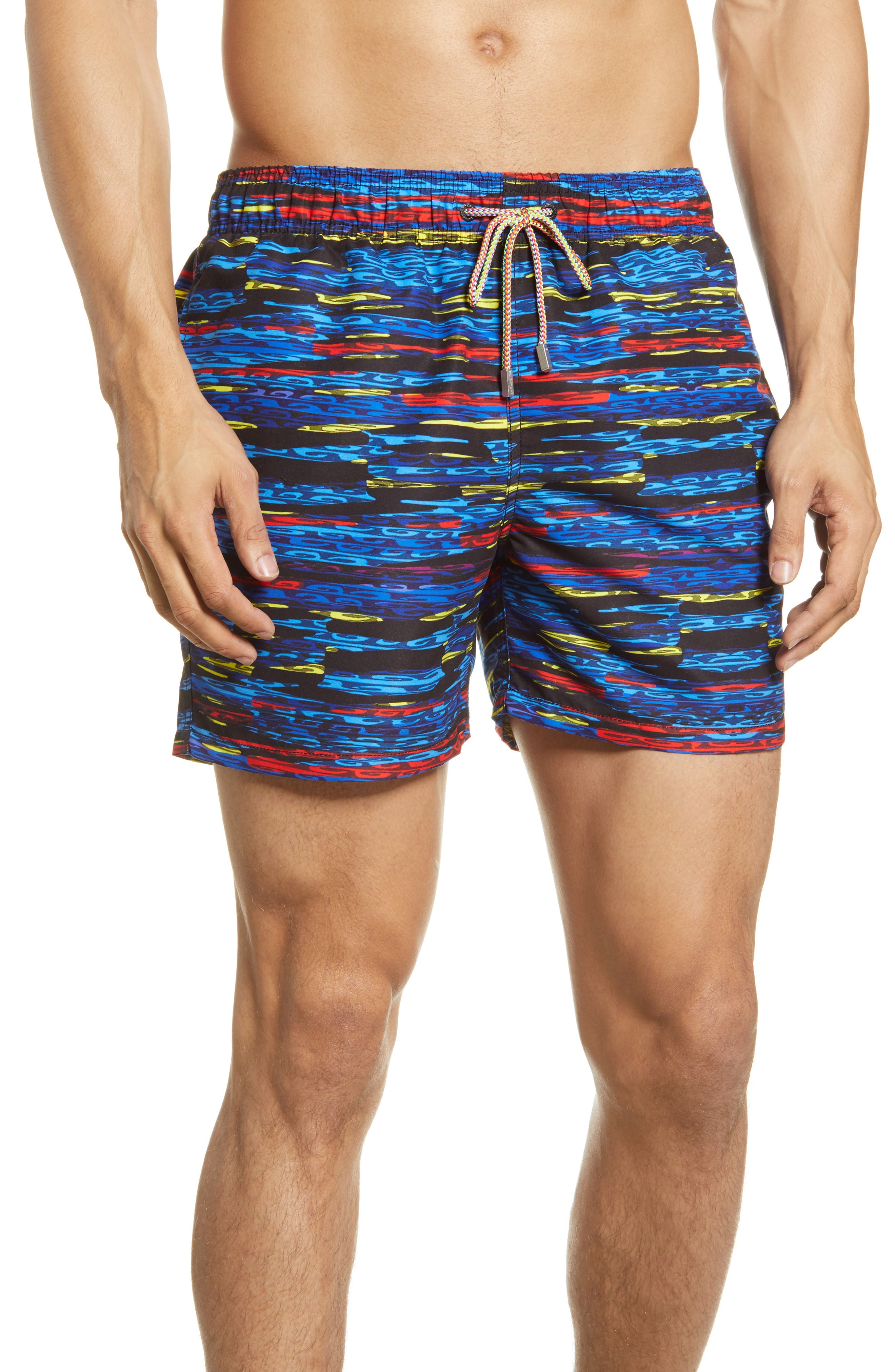 Watery ripples splash in bright colors across swim trunks cut from lightweight, quick-drying fabric that offers comfort in and out of the water. Style Name: Bugatchi Ripples Swim Trunks. Style Number: 6039655. Available in stores.