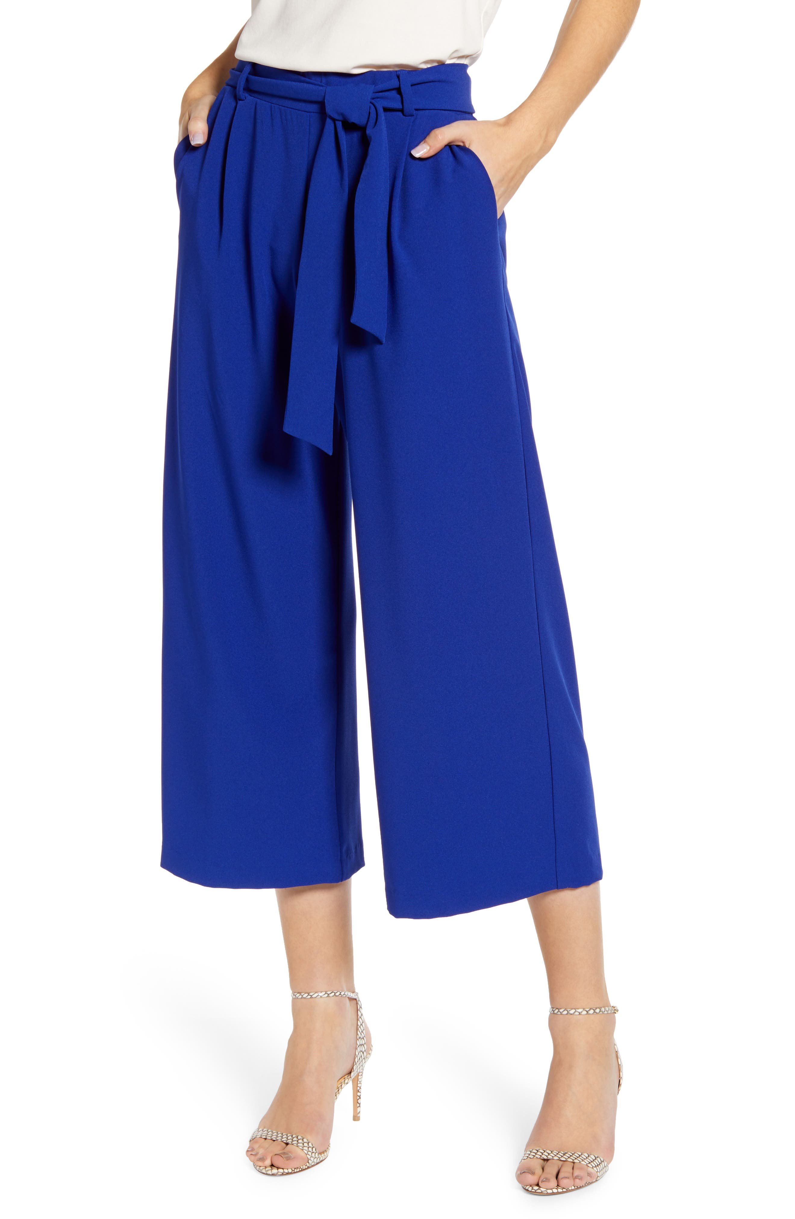 A drapey waist tie tops these flowy cropped pants punctuated with stylish cropped legs. Style Name: Loveappella Wide Leg Crop Pants. Style Number: 6000725. Available in stores.