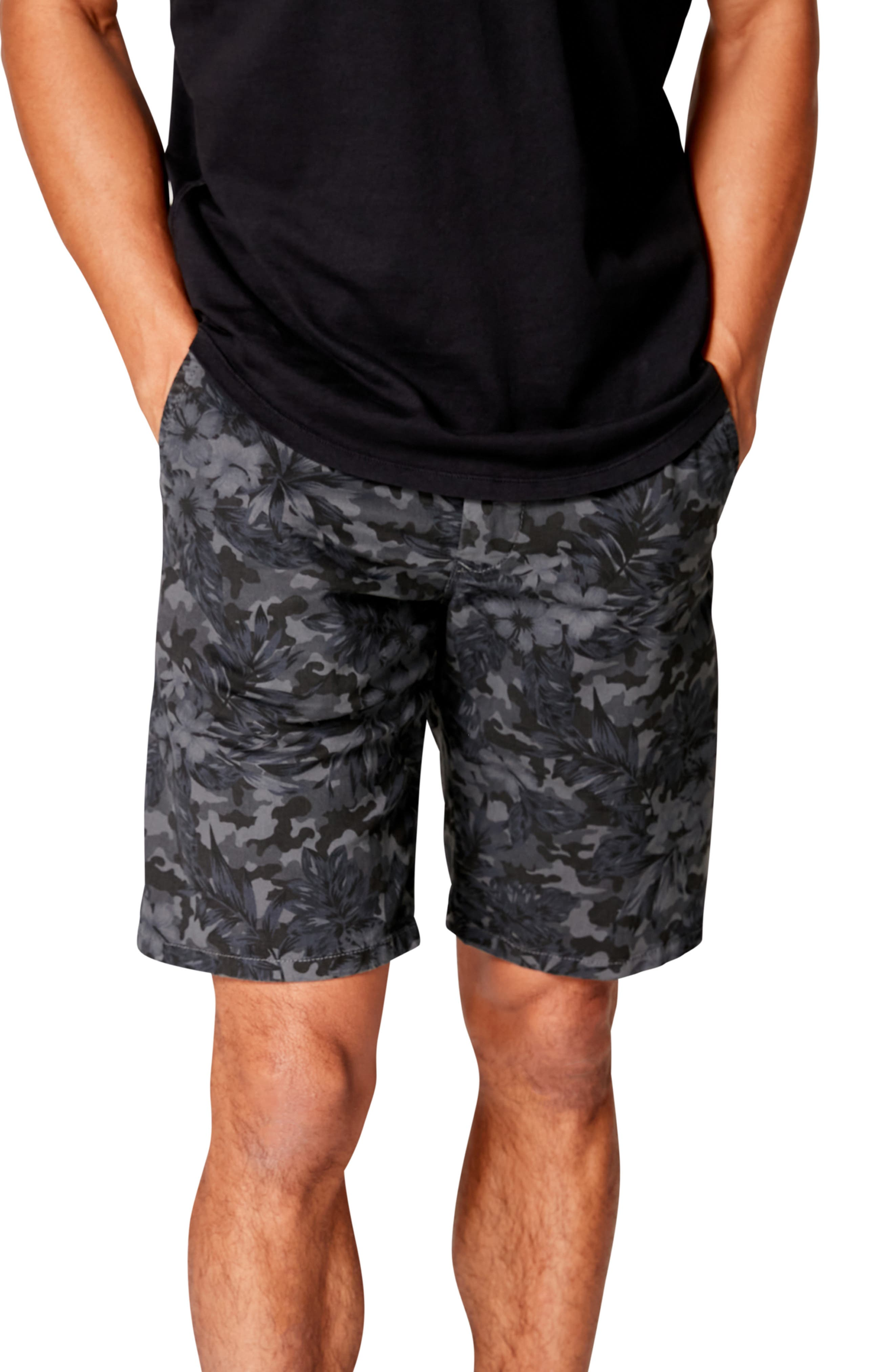 Mottled camo and tropical flowers bring the best of both trends to stretch-cotton shorts styled for comfort with angled side seams to give you easier movement. Style Name: Good Man Brand Monaco Slim Fit Camo Floral Flat Front Shorts. Style Number: 6020234. Available in stores.