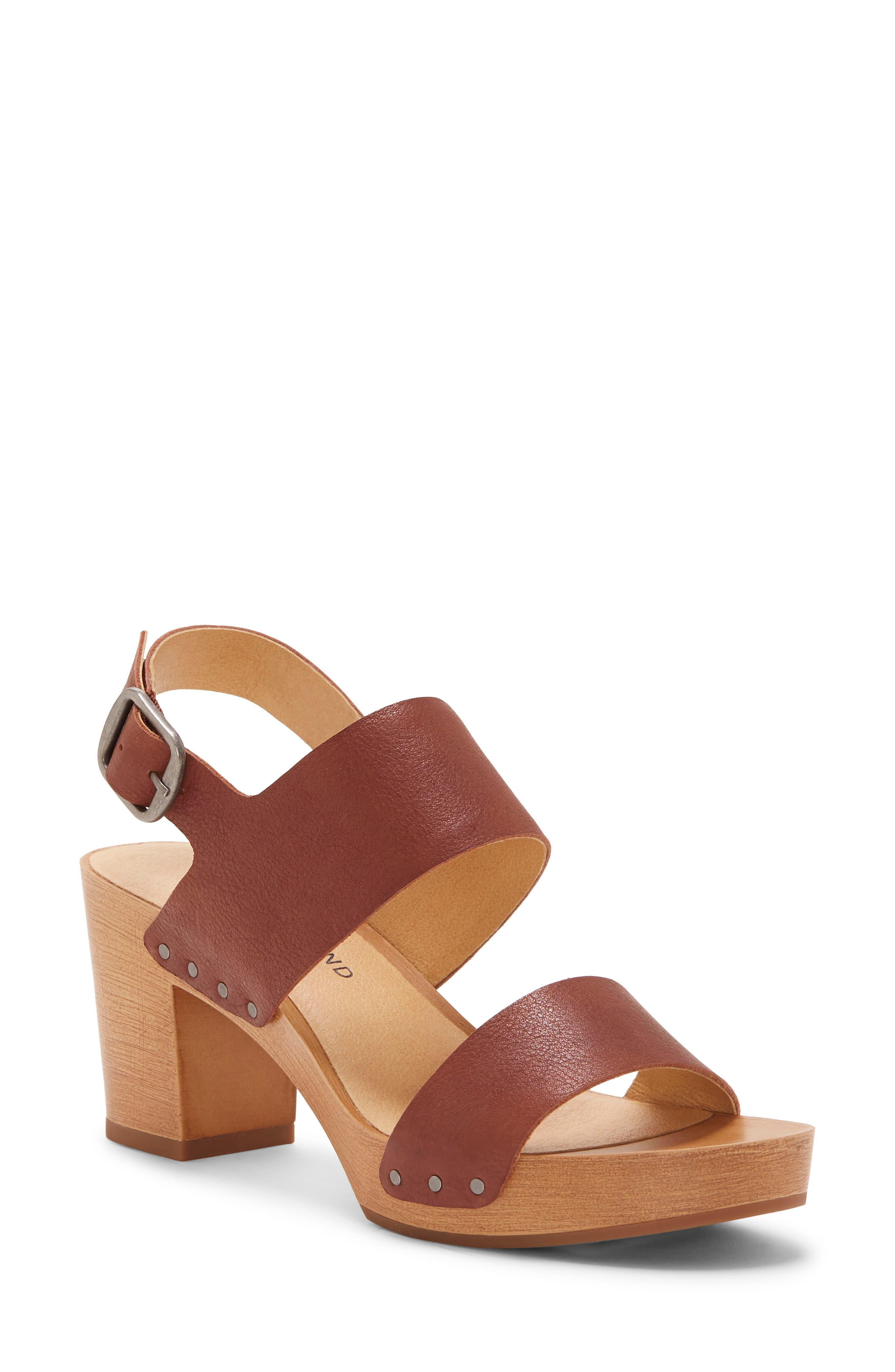 A single-piece woodgrain heel and platform further the \\\'70s-inspired appeal of a breezy clog-inspired sandal styled with smooth leather straps. Style Name: Lucky Brand Hemzi Sandal (Women). Style Number: 5958395. Available in stores.
