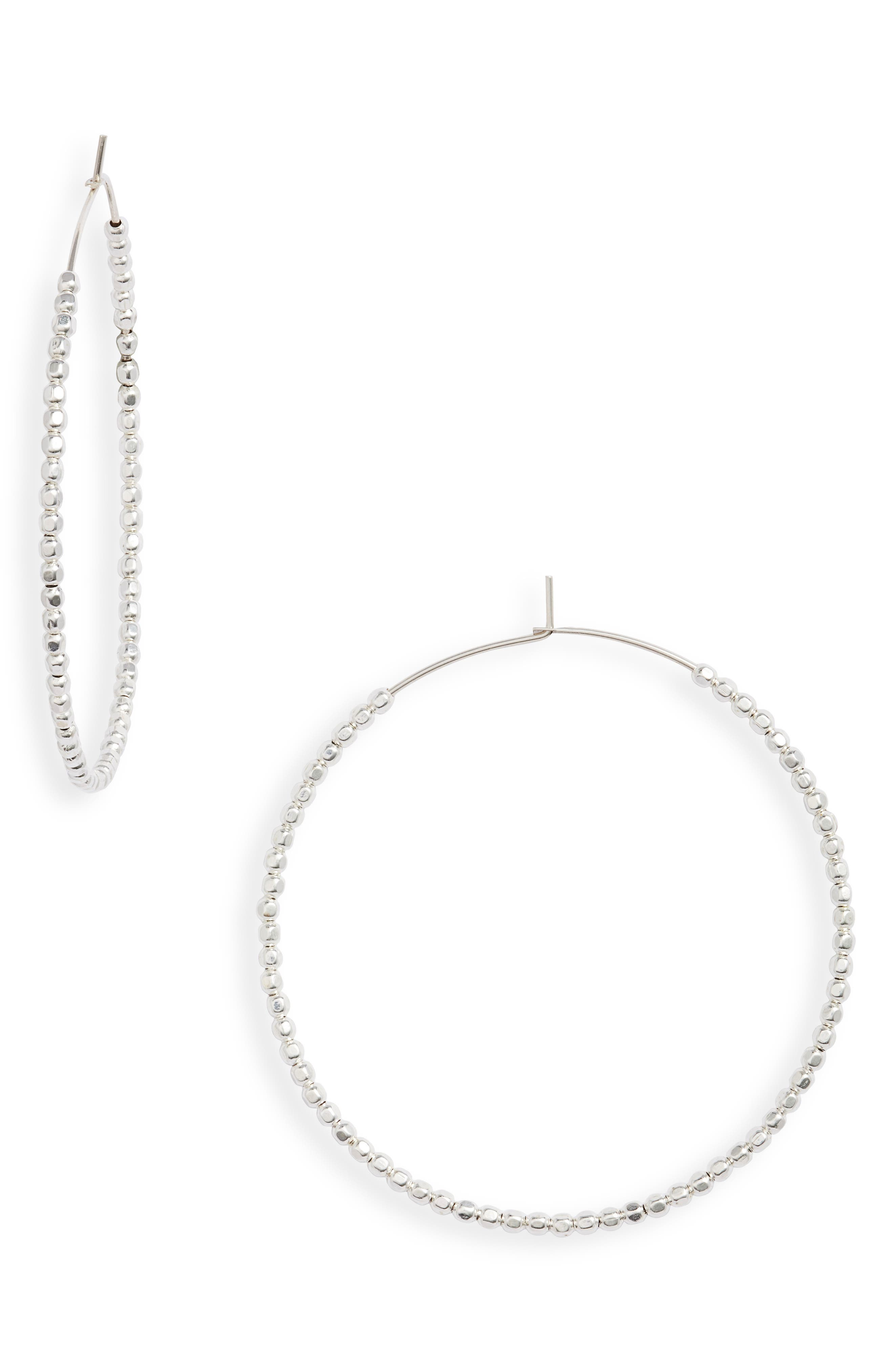 These large wire hoops threaded with metal beads pack a lot of chic attitude. Style Name: Set & Stones Erin Hoop Earrings. Style Number: 5966507. Available in stores.