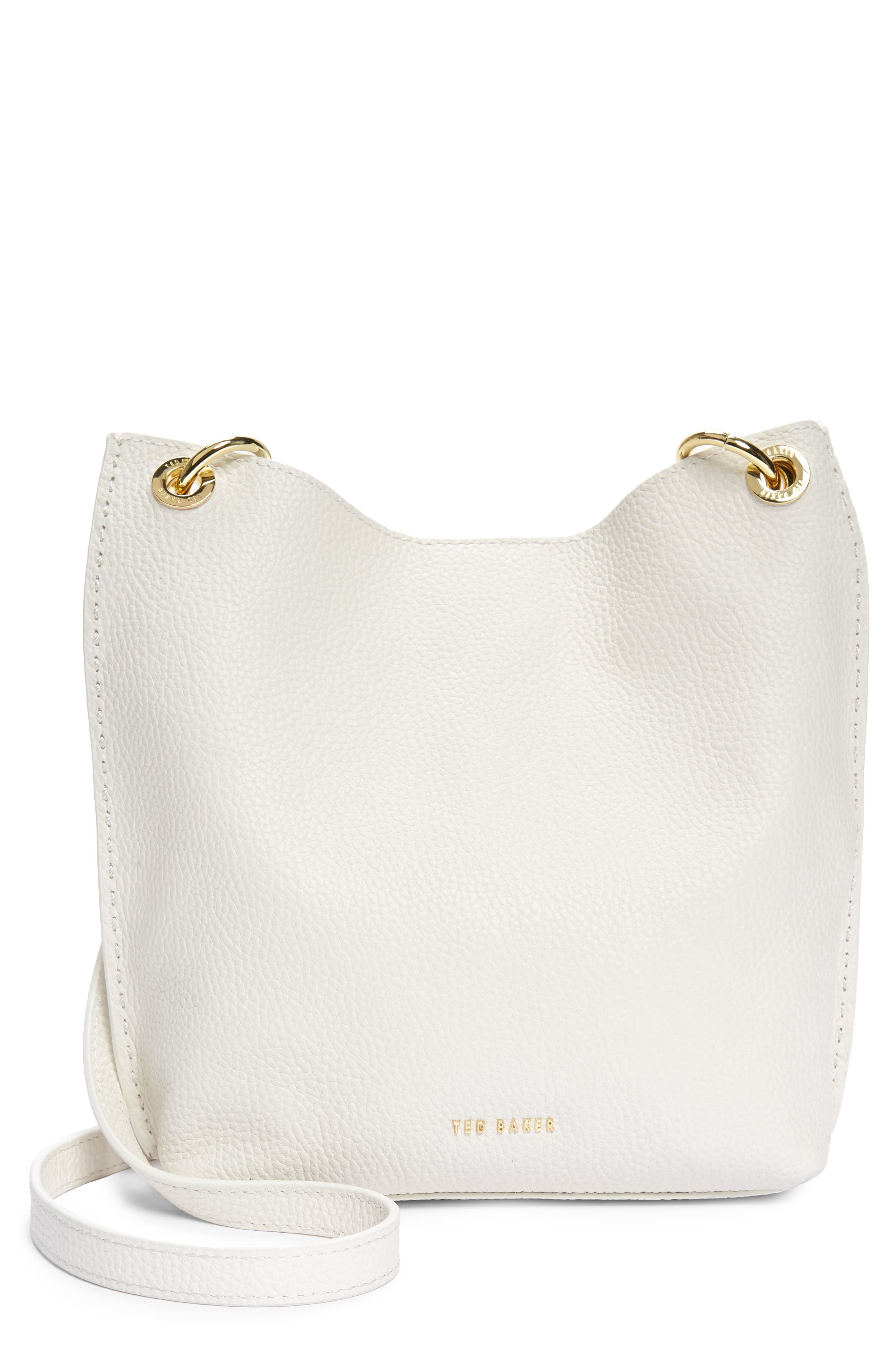 A chain-detailed crossbody strap polishes the look of a grained calfskin-leather hobo that has the perfect balance of softness and structure. Style Name: Ted Baker London Mini Holiiee Leather Crossbody Bag. Style Number: 6064433. Available in stores.