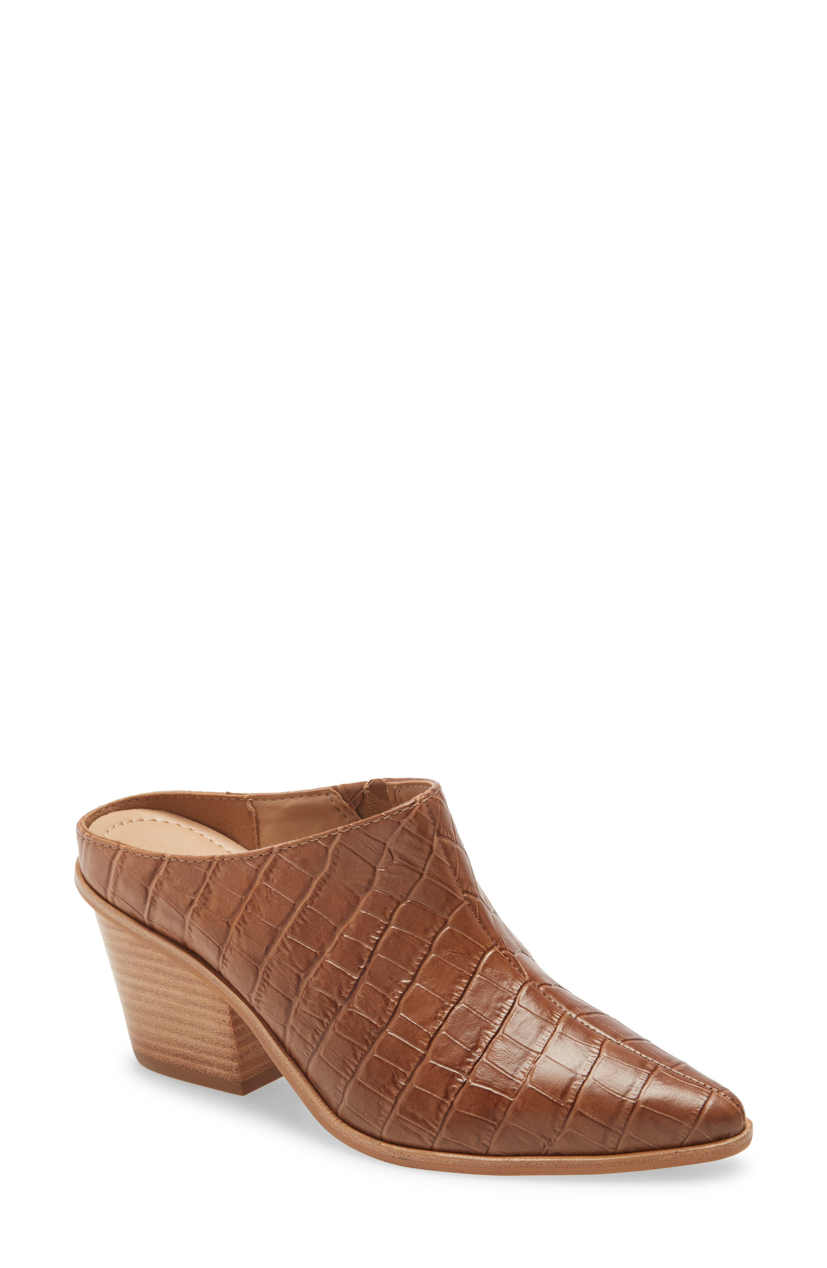 This rustic mule is styled with a seam-centered pointy toe, a sturdy stacked heel and a bit of goring for flexibility for putting it on and taking it off. Style Name: Kaanas Brunello Mule (Women). Style Number: 6102653. Available in stores.