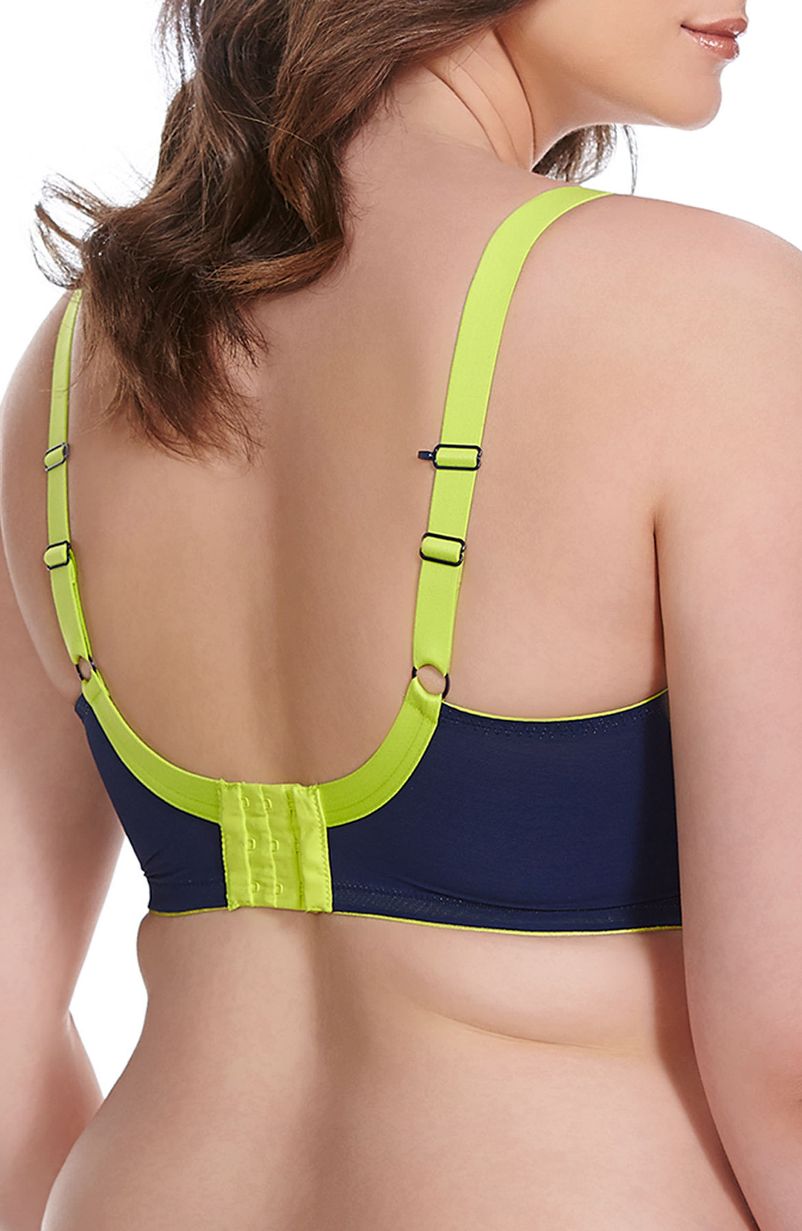 Exercise with complete confidence in a moisture-wicking microfiber sports bra designed with a uniquely constructed underwire that creates flattering separation and minimizes movement. Four-part cups with side support offer exceptional lift and hold. Style Name: Elomi Energise Sports Bra (Plus Size). Style Number: 260999. Available in stores.