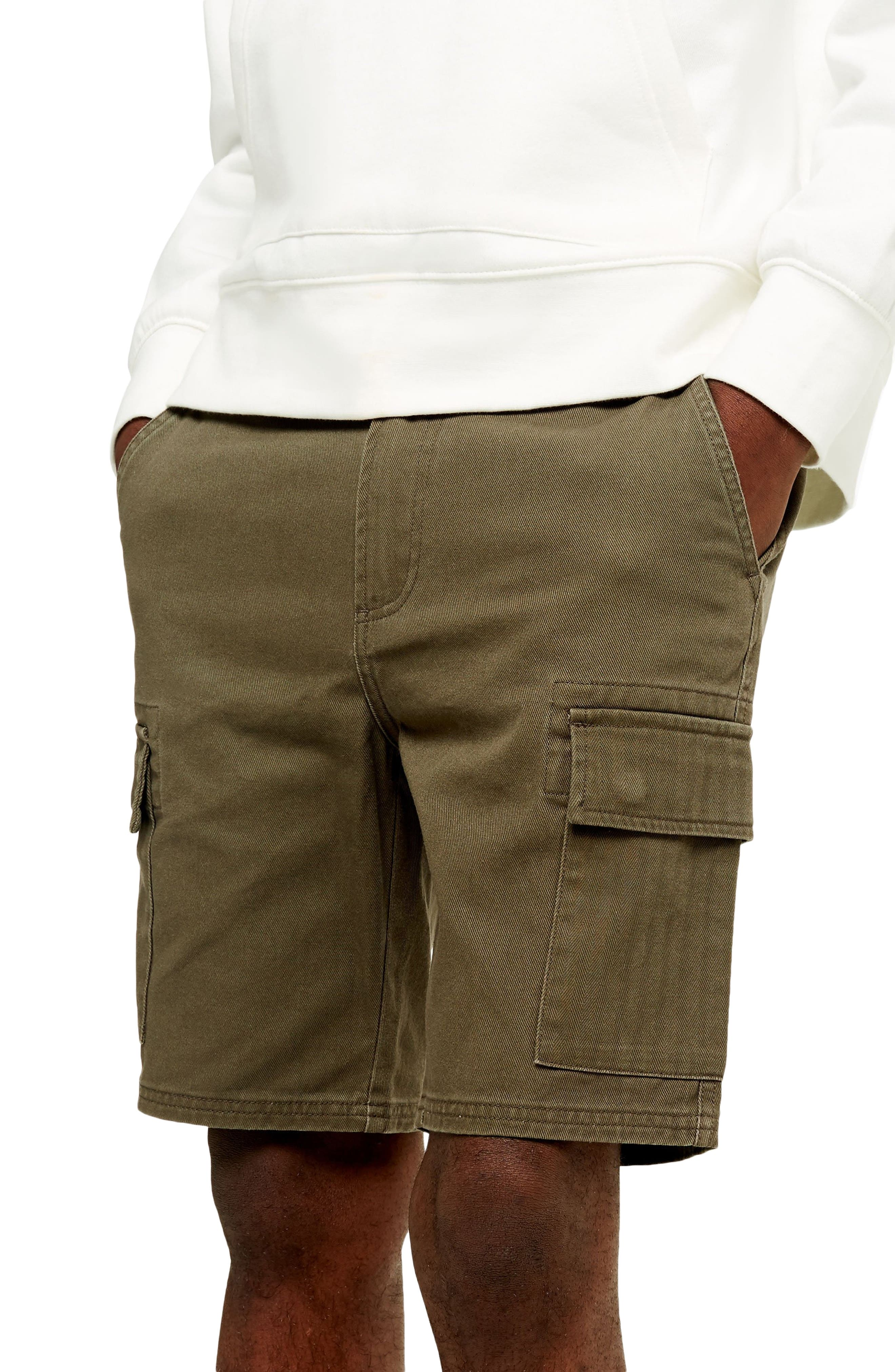 Tough cotton twill and herringbone on the pockets define easy cargo shorts with versatile appeal. Style Name: Topman Classic Cargo Shorts. Style Number: 5985865. Available in stores.