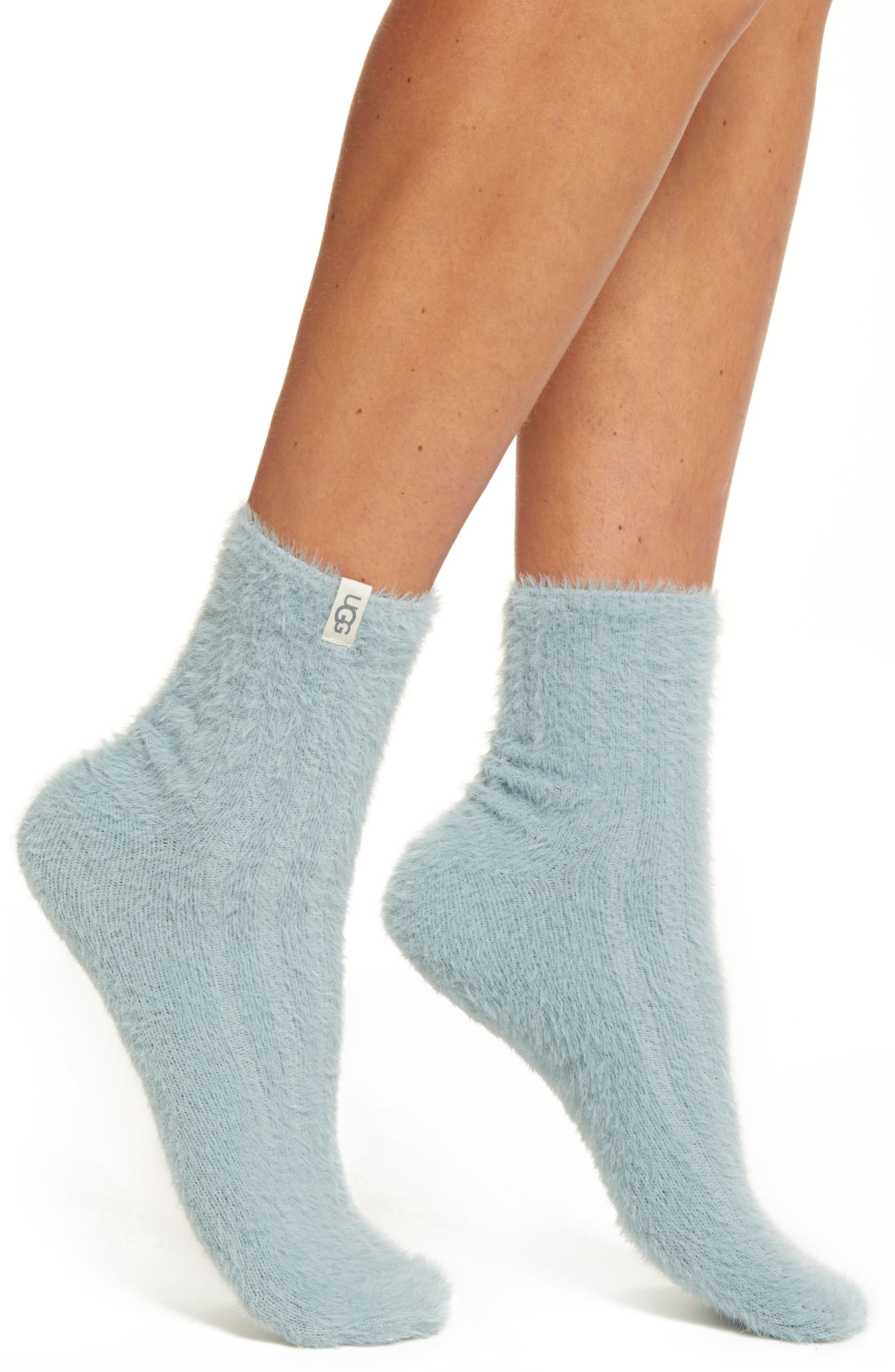 Treat your feet to fuzzy softness with these quarter-crew socks finished with a logo on the cuff. Style Name: UGG Peyton Quarter Crew Socks. Style Number: 6103385. Available in stores.