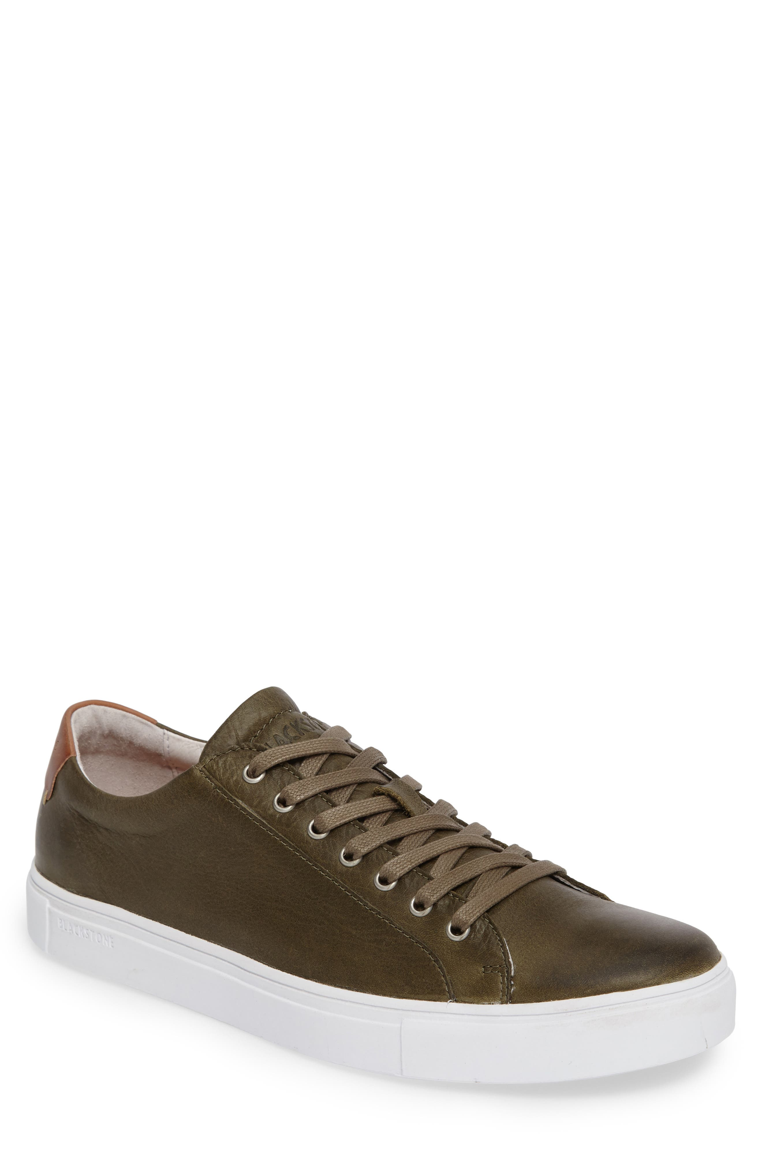 Every man needs a leather sneaker in his wardrobe, and this one is cut with a classic low profile that pairs well with any sporty-casual look. An elongated lacing system cinches the laid-back style, while an optic-white cupsole enhances the sporty vibe. Style Name: Blackstone Nm01 7 Eyelet Sneaker (Men). Style Number: 5411547. Available in stores.