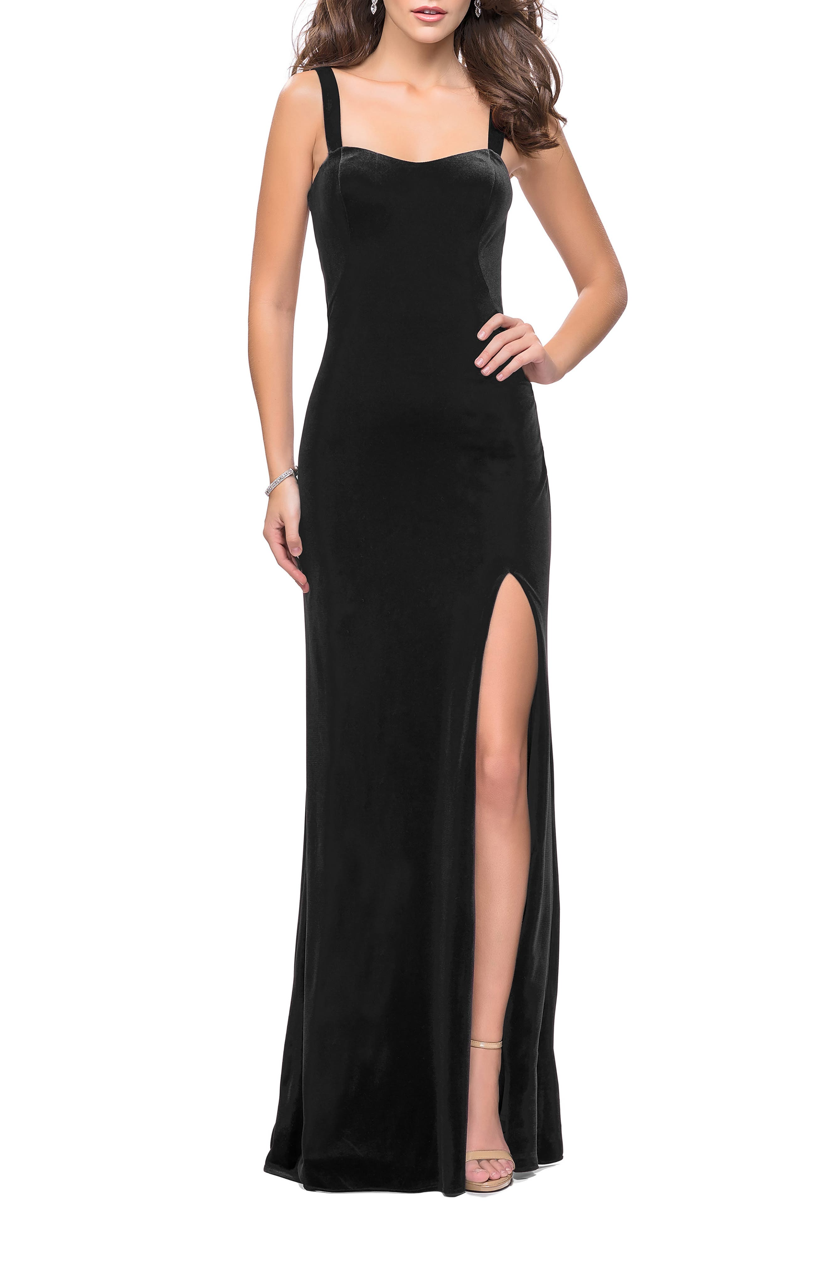 Turn heads from all directions in this regal column dress designed with a deep side slit and a dramatic, strappy back with horizontal pleats at the hips. Style Name: La Femme Velvet Column Gown. Style Number: 6170016. Available in stores.