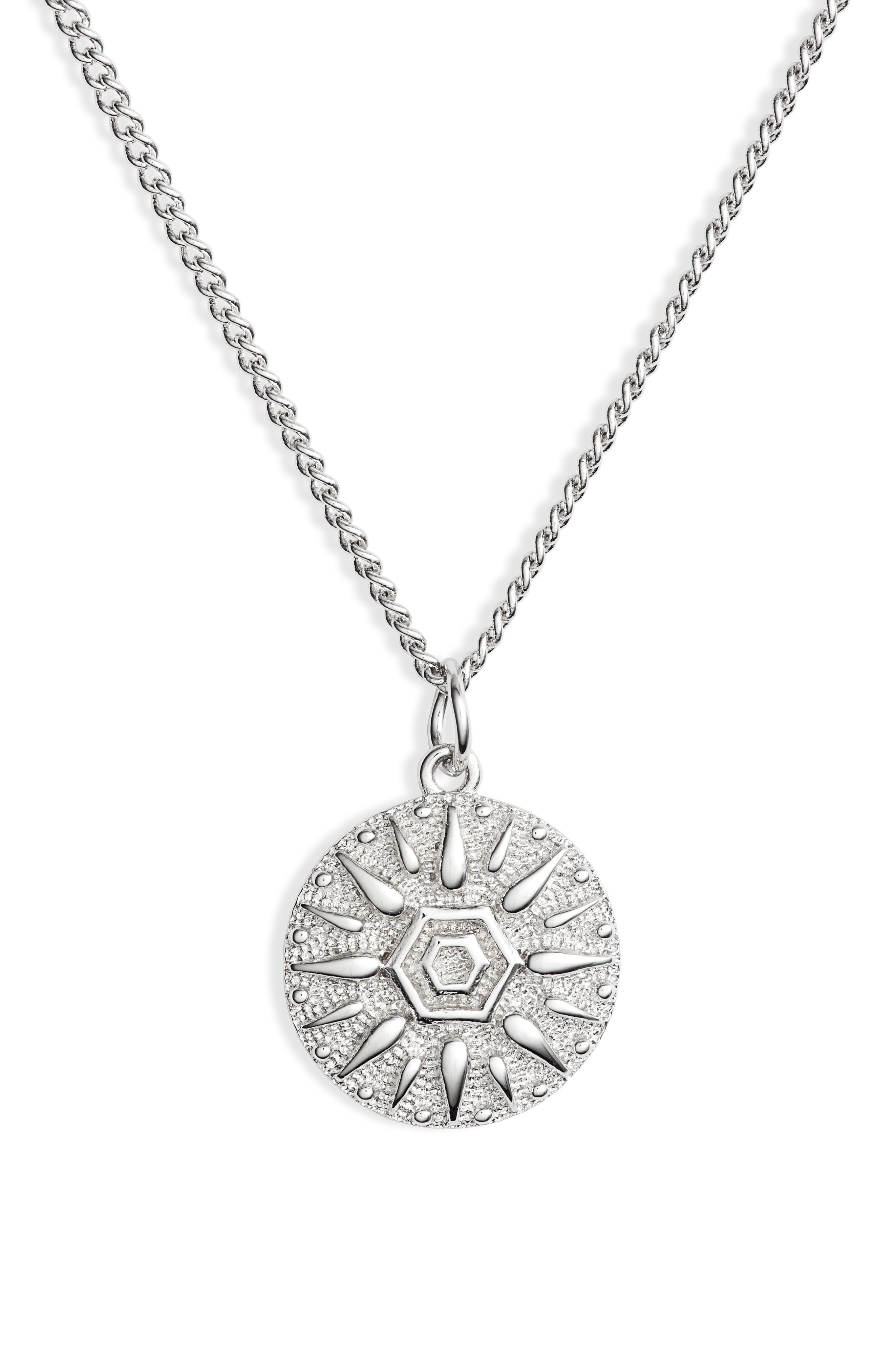A gleaming sun disk pendant dangles elegantly from a long, delicate chain. Style Name: Sterling Forever Sun Disk Pendant Necklace. Style Number: 5799856. Available in stores.
