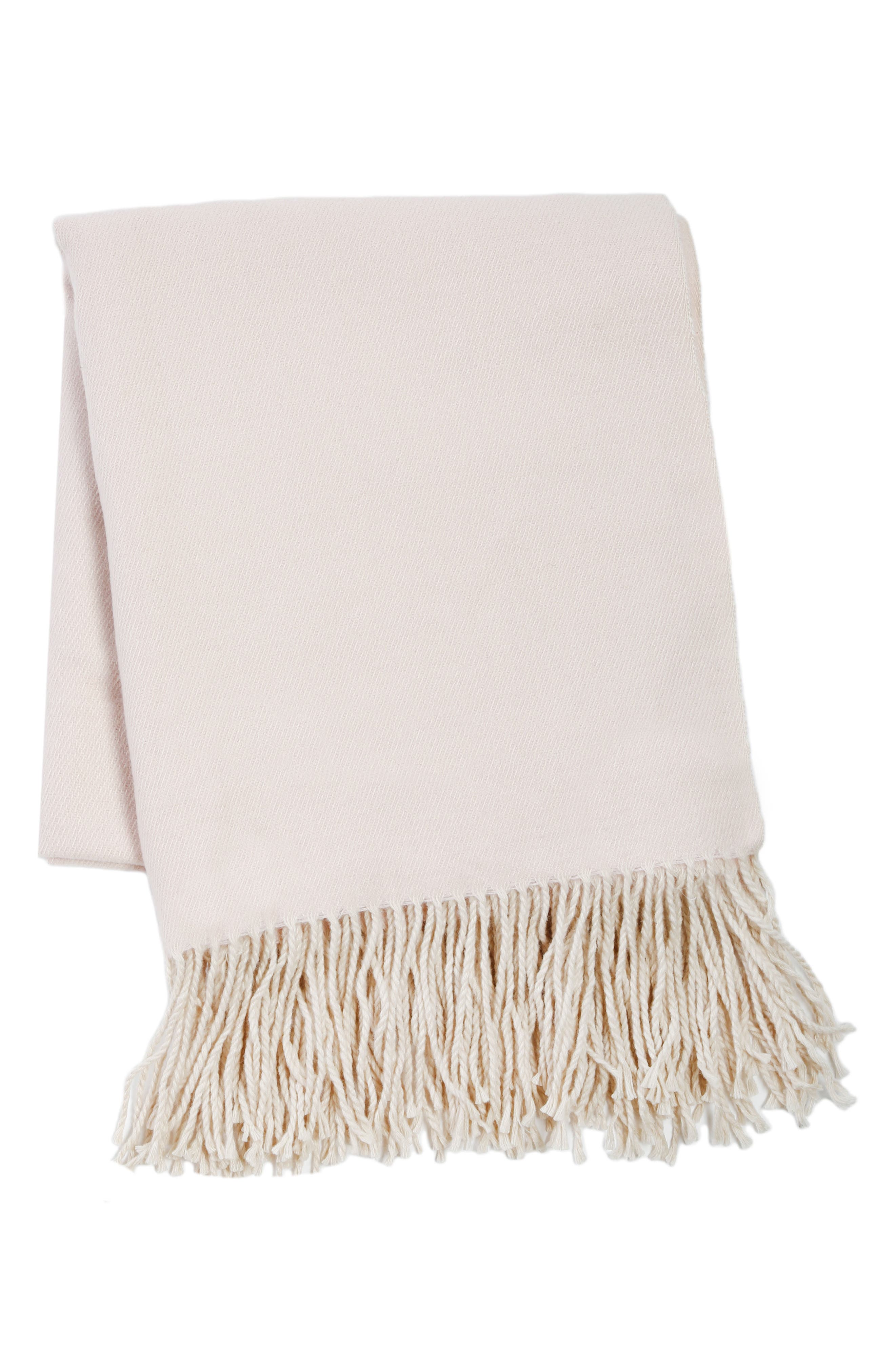 Fringe trim furthers the casual sophistication of a lightweight throw that coordinates with a wide range of decor. Style Name: Pom Pom At Home Morgan Throw. Style Number: 5629260. Available in stores.