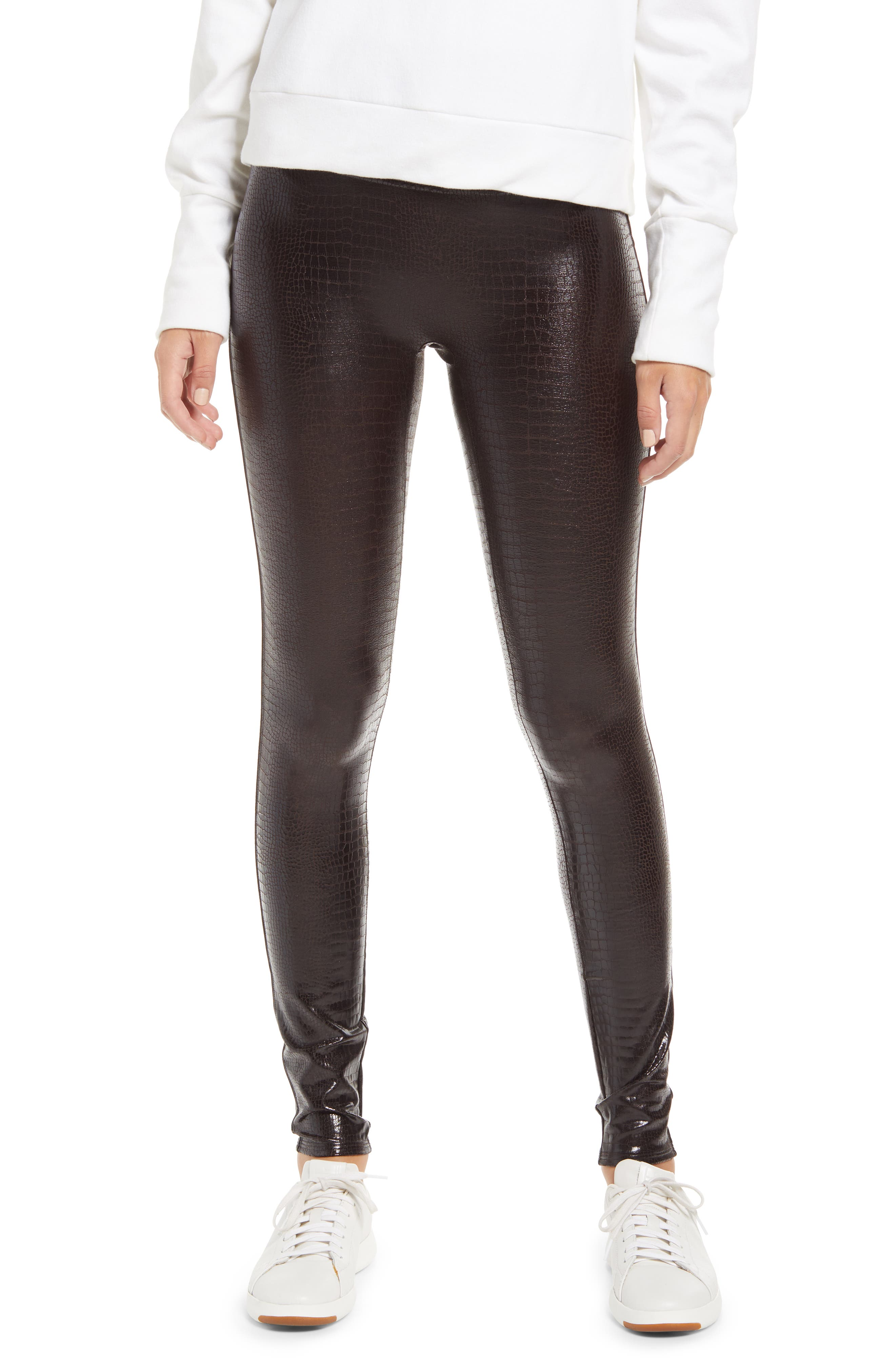 With chic croc texture and glossy shine, these lightly shaping faux-leather leggings make a sophisticated base for casual and elevated outfits alike. Style Name: Spanx Croc Embossed High Waist Faux Leather Leggings. Style Number: 6095589. Available in stores.
