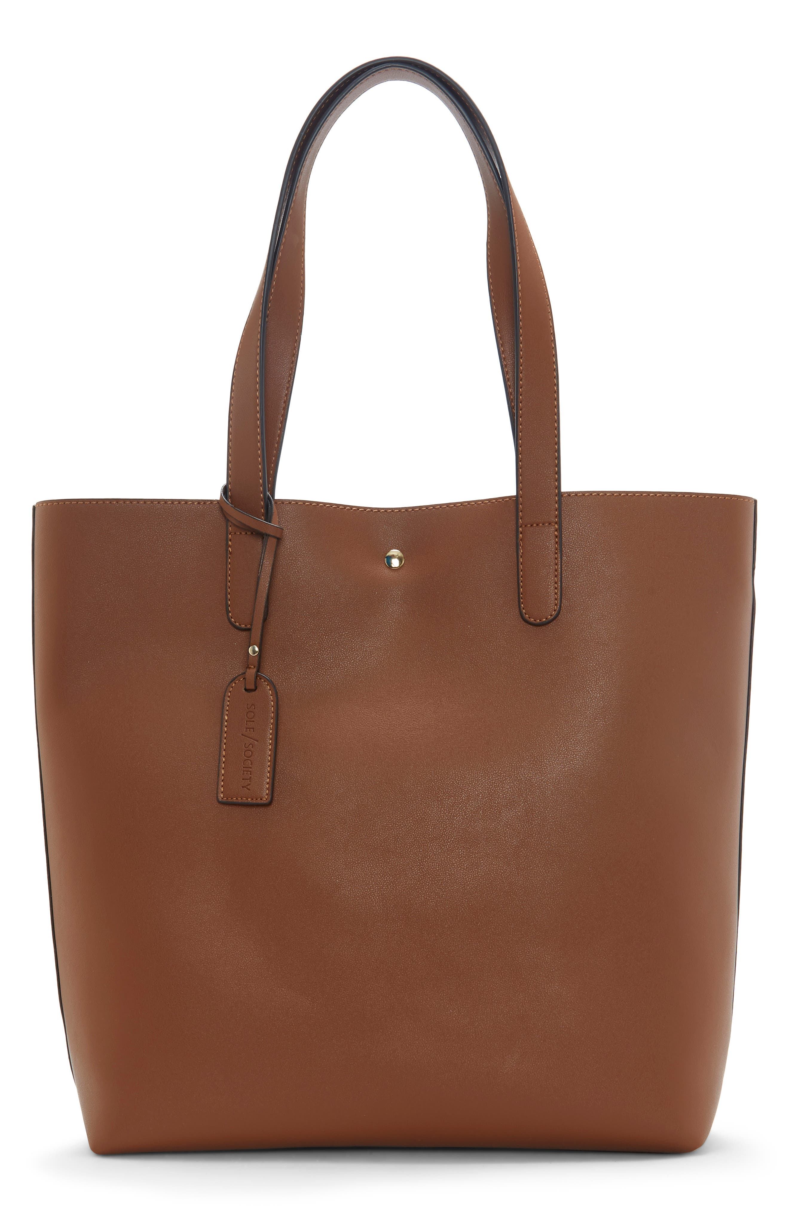 This smooth faux-leather tote is nice and deep so you can toss almost anything into it throughout the day. Style Name: Sole Society Hyda Faux Leather Tote. Style Number: 6070477. Available in stores.