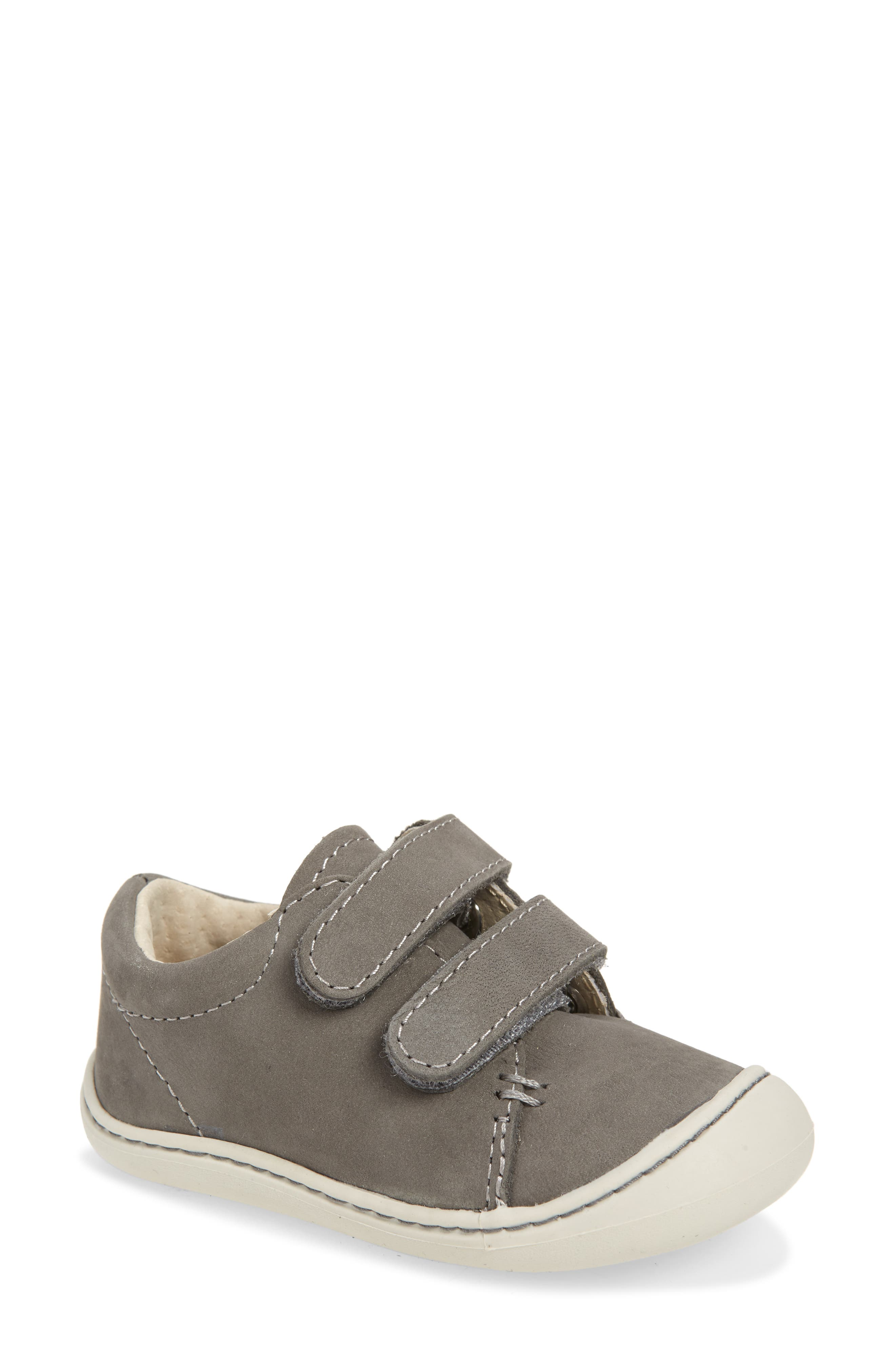 Two easy-on bridge straps make it a cinch to secure this super-comfortable leather sneaker to even the littlest of feet. The wide, flat base helps promote balance and confident early steps for beginning walkers. Style Name: Footmates Henry Sneaker (Baby, Walker & Toddler). Style Number: 5890358. Available in stores.