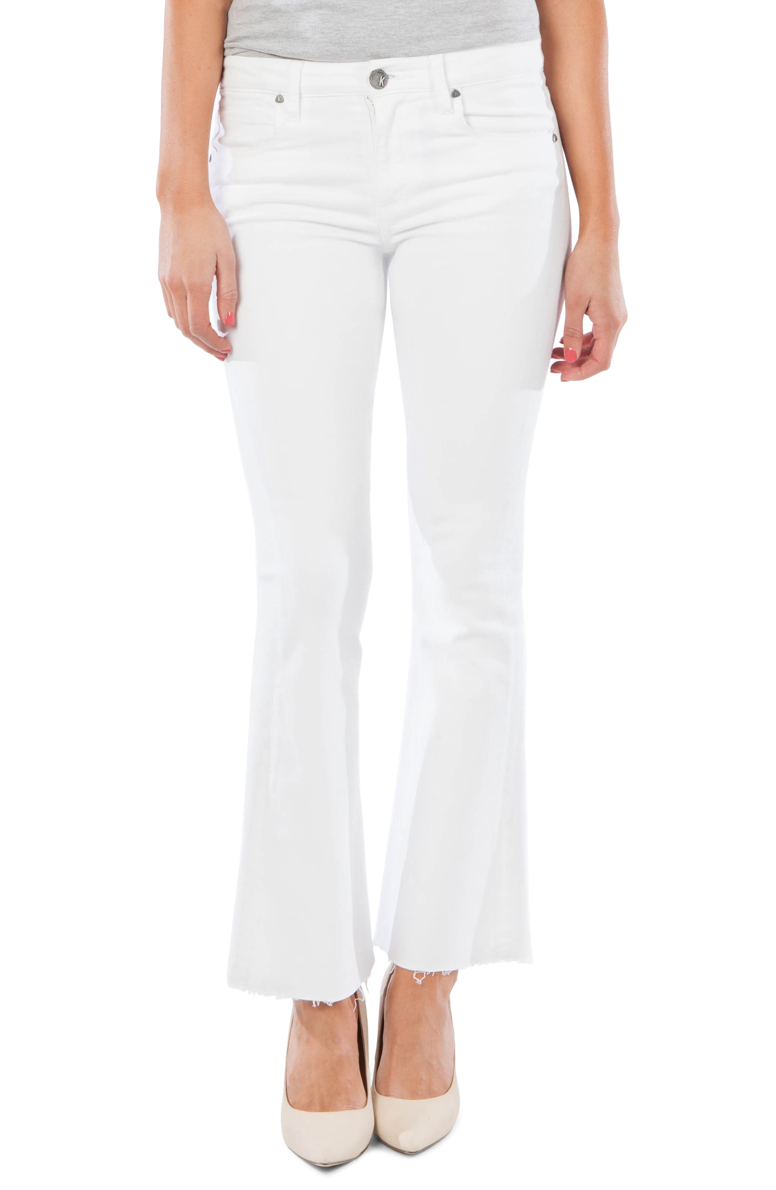 Brighten any ensemble with the vintage vibe of optic-white flared jeans cut from soft denim and finished with trendy frayed hems. Style Name: Kut From The Kloth Stella Fray Hem Flare Jeans (Optic White). Style Number: 5797259. Available in stores.
