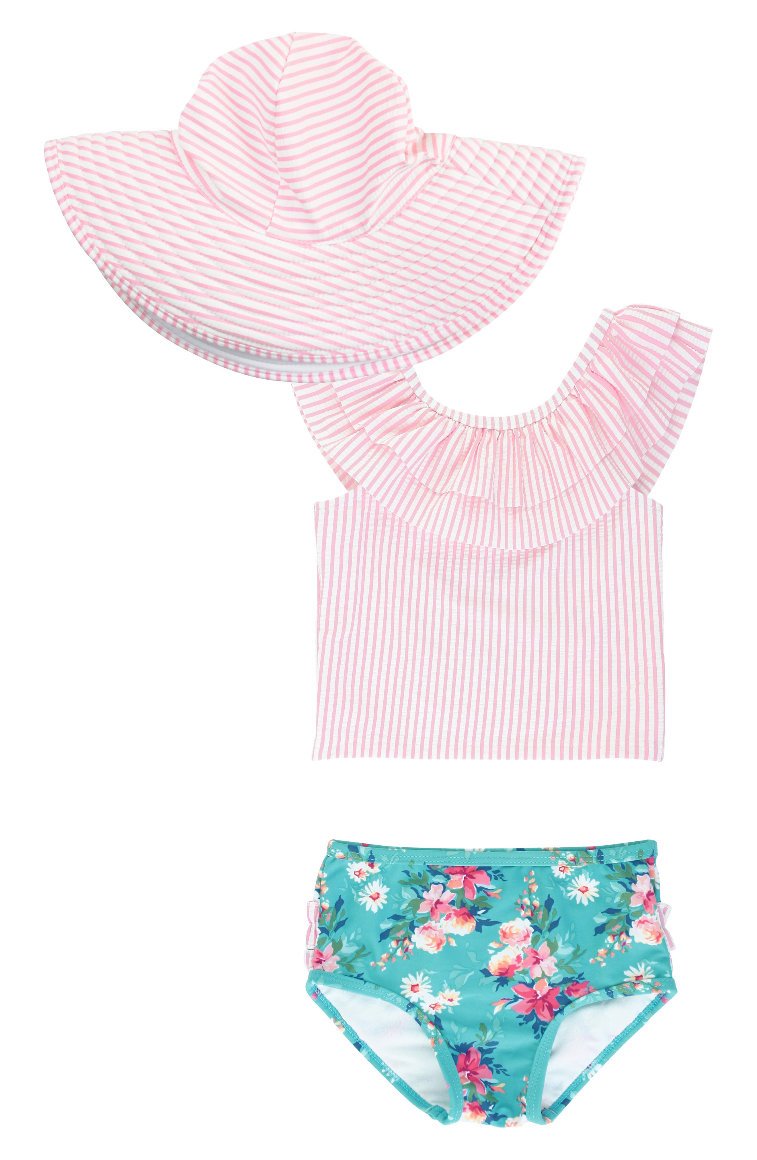 Bright seersucker stripes and ruffled trim add ample retro charm to a beach-ready tankini swimsuit paired with an adorable floppy hat for extra sun protection. Style Name: Rufflebutts Fancy Frill Two-Piece Swimsuit & Floppy Hat Set (Baby). Style Number: 5938576. Available in stores.